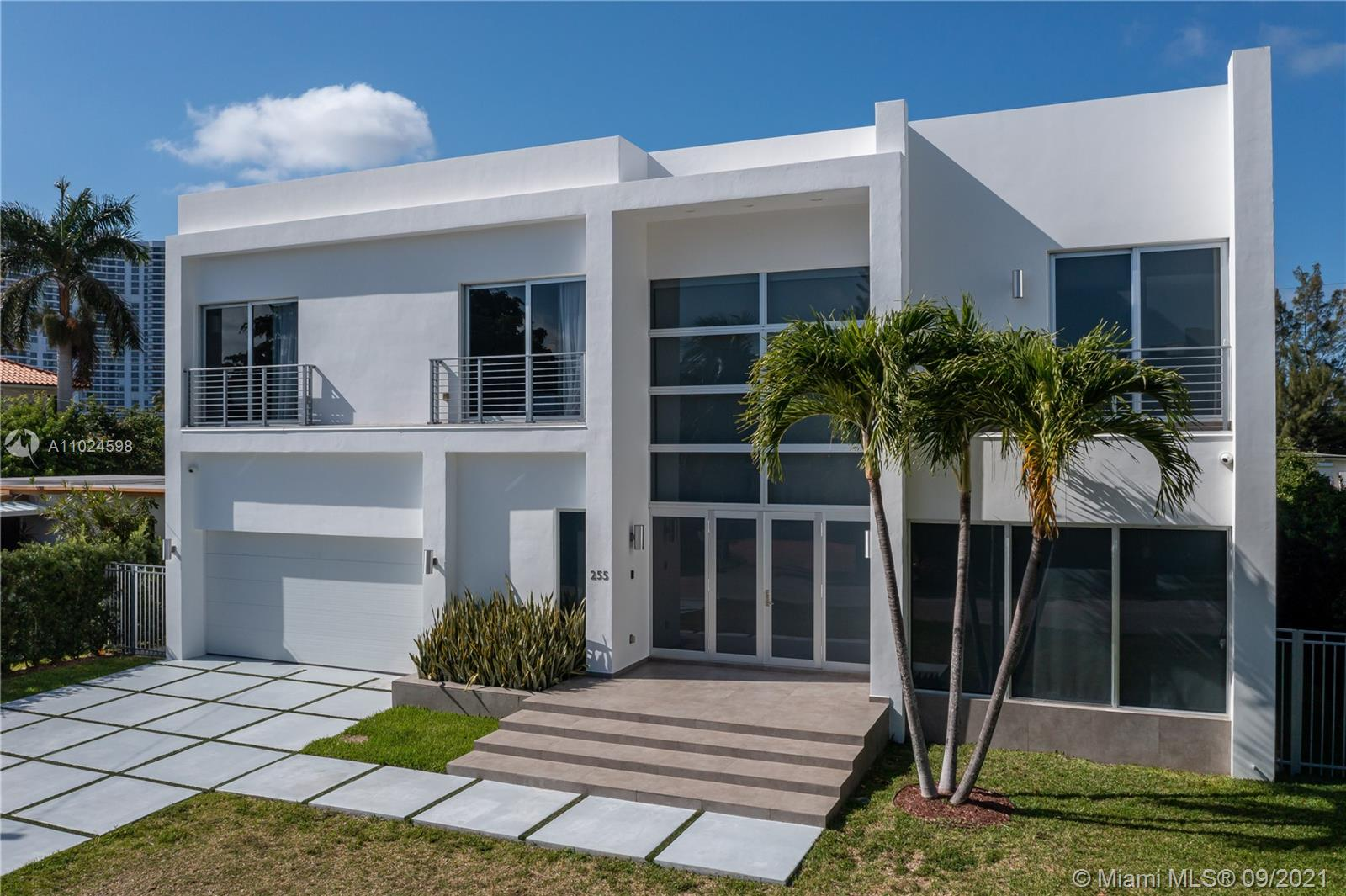 Stunning contemporary masterpiece built-in 2017 being offered fully furnished with high-end Italian furnishings. No expense was spared in this home's interior utilizing luxurious finishes to complement its open concept floor-plan. Spanning over 5,000 s/f of living, Florense kitchen with Carrara marble tops & subzero appliances, impact windows/doors, frameless soundproof interior doors & custom Italian closets, elegant European wallpaper, a master BD wing w/ his & hers closets, Smart Home tech with Lutron lighting and exterior camera system, upscale light fixtures & window treatments, spacious heated pool with wood deck and covered patio entertainment area. Located in desirable Sunny Isles Beach steps from ocean, houses of worship, elegant restaurants & shopping. A+ School District.