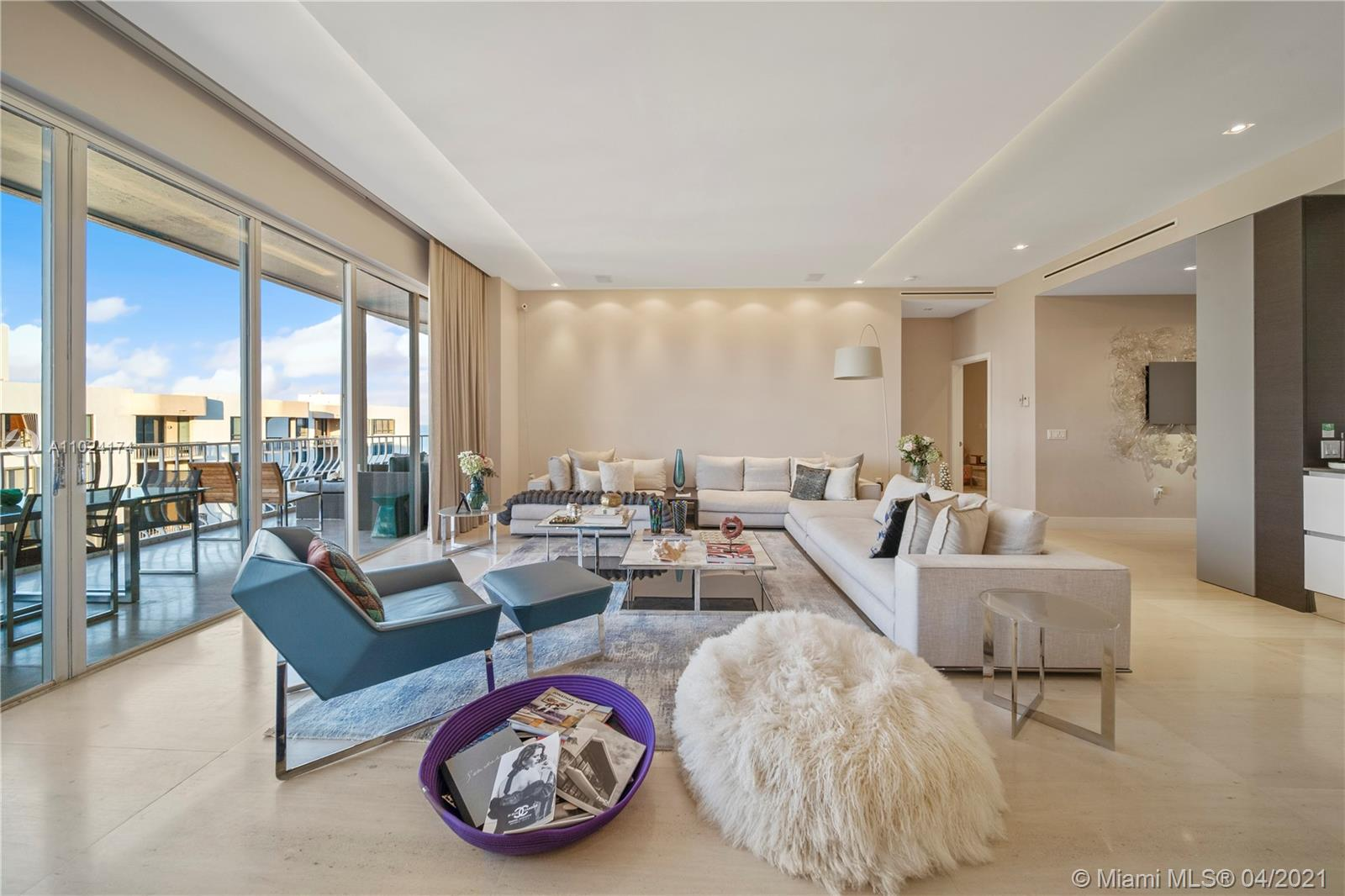 ABOUT THIS ONE OF A KIND L-PH unit. With spectacular horizons from ocean to Intracoastal views, this L-Penthouse located on the most desirable zip code, provides a true layout designed by renowned architect in Brazil. This is for sure, a very unique unit that features 4 bedrooms and 4 baths in addition to well-apportioned dining and living areas. With a limestone flooring throughout the unit, spacious Kitchen equipped with Molteni & C | Dada, Miele appliances, automated window treatments and all bathrooms finishes from Hansgrooe by famous Italian designer Patricia Urquiola. You can't miss this opportunity to enjoy a breathtaking taken sunset view, over the beautiful Bal Harbor Marina. Full service building, private restaurant, tennis court, clubroom and a full gym. **partially furnished**