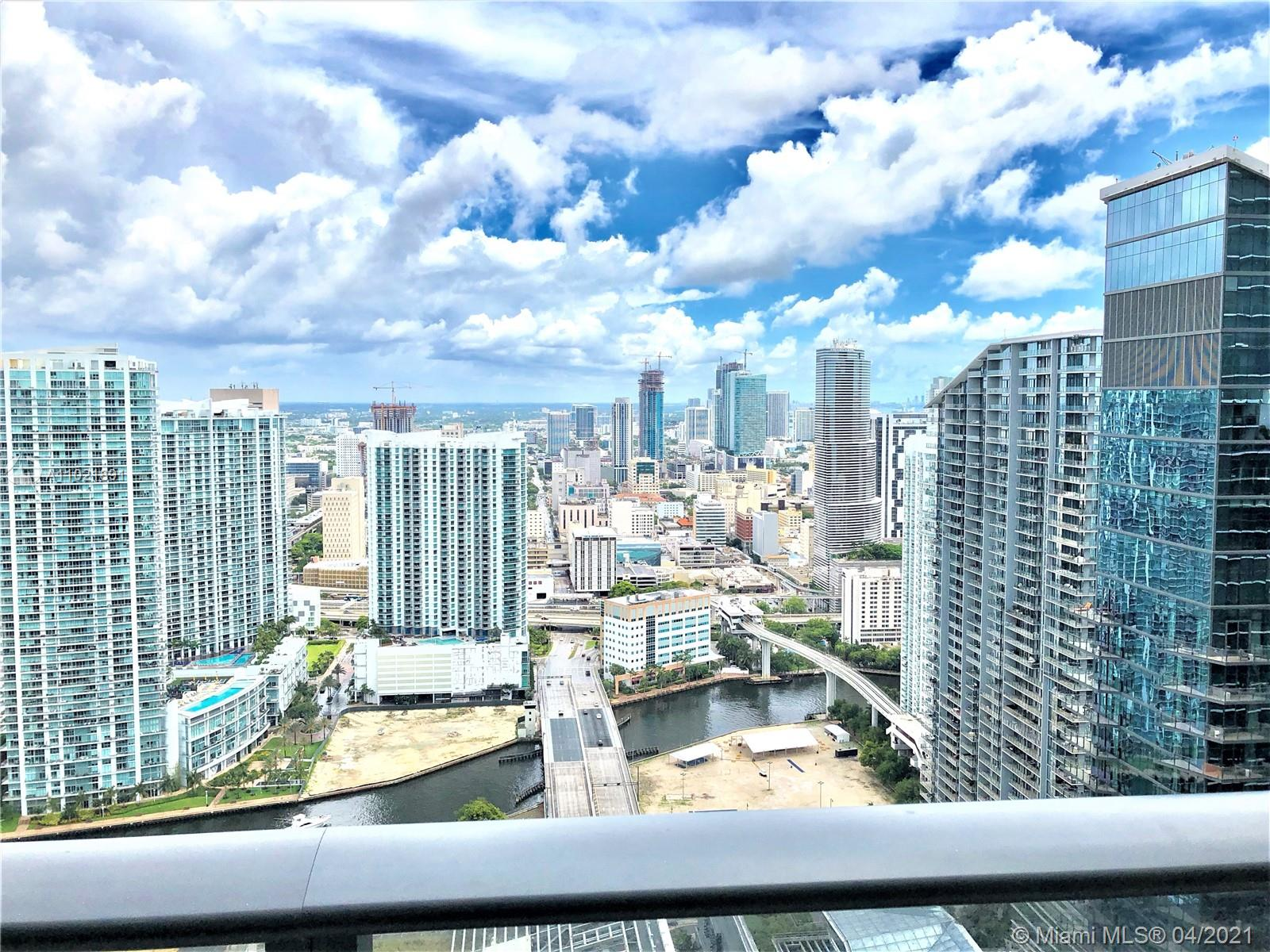 1,753 interior + 305 balcony : 2,058 total living space. Floorplan attached. Opulent PH Living - Brickell Heights East LPH 4609 - Exceptional views. 12+ foot ceilings. 3 full en-suites plus additional half bath for guests. Design offers an additional office/den, a separate large utility room with full size washer and dryer on pedestals, every room with oversized custom closets including a triple sized walk-in in main bedroom. Custom glass treatments in all rooms. Upgraded Miele and Subzero appliances. 3 premium non-lift self parking spaces. Amenity rich building in a museum like modern art setting. Stunning rooftop pool and lounge. Easy to show. Also available fully furnished/turnkey.