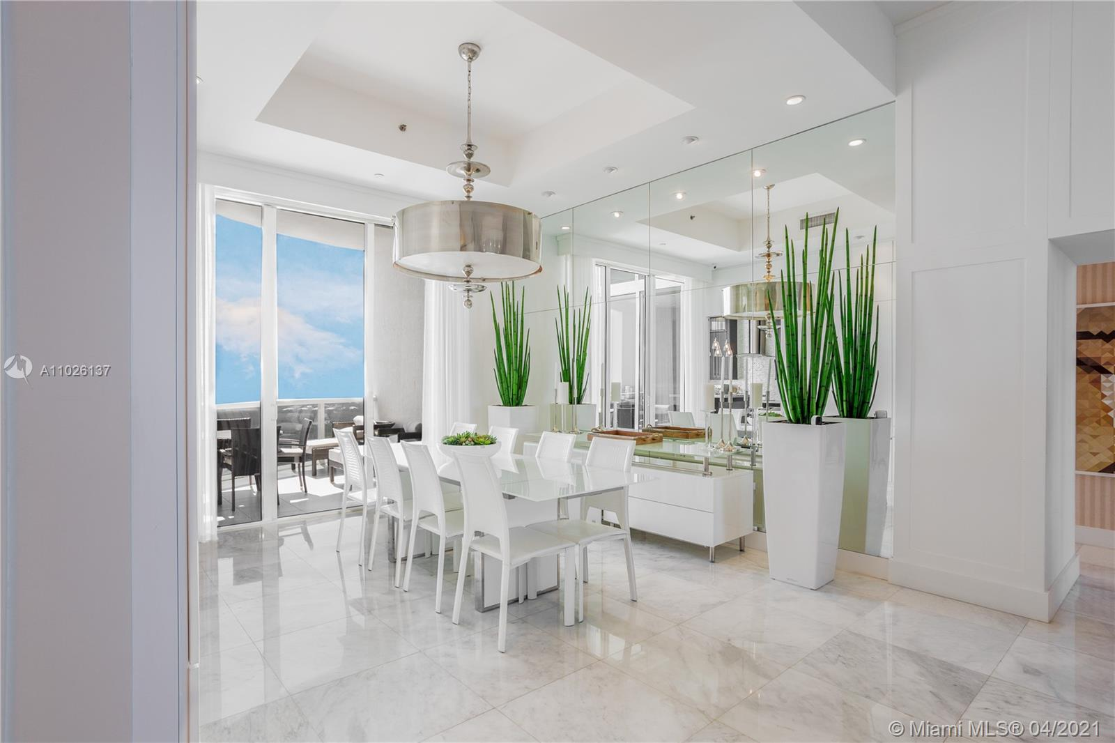 """BREATHTAKING DIRECT OCEAN, INTRACOASTAL AND CITY VIEWS. PROFESSIONALLY DECORATED 3 BED & 3.5 BATH. EAST TO WEST FLOW THRU UNIT 12"""" CEILINGS. APARTMENT COMES WITH AUTOMATED SISTEM BY CRESTON,  CONTROLS LIGHTS, SHADES AND AIR CONDITION. THIS APARTMENT HAS  TOP OF THE LINE APPLIANCES,ITALIAN KITCHEN, WINE COOLER & BUILT IN ESPRESSO MACHINE. STATE OF THE ART GYM/SPA, POOL SERVICE, RESTAURANT IN THE BUILDING, BUSINESS CENTER. CLOSE TO BAL HARBOUR SHOPS, AVENTURA MALL."""