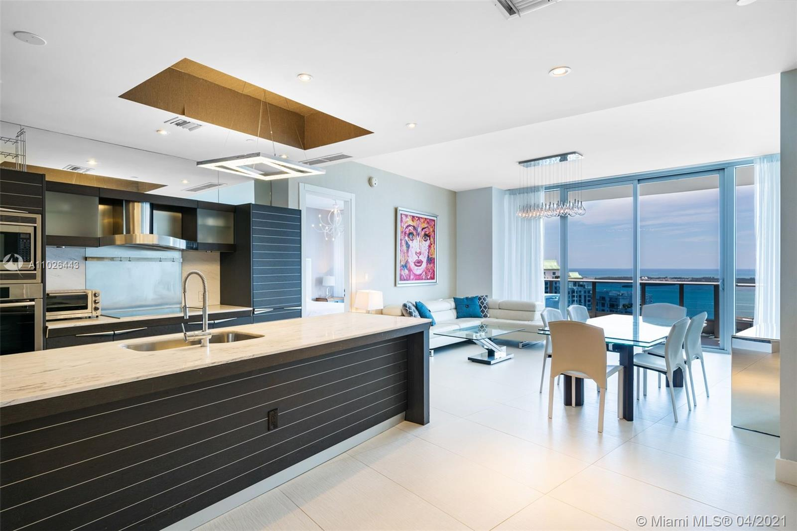 """RENTED until 06/22 FOR $8500. 2 beds + enclosed Den +2.5 baths + additional Storage unit. Turn-key unit in pristine condition with unobstructed and majestic views of the Biscayne Bay and the Atlantic Ocean. Located in the heart of Brickell, where the Miami River meets the bay, within walking distance to upscale shopping, fine dining and entertainment. Epic amenities includes 2 pools,  poolside cabanas, fitness center, Exhale spa, public marina and bar along with ZUMA Restaurant (ground floor) and Area 31 on the pool level. Epic was designed and built by renown developer  Ugo Colombo & Lionstone Development and the units feature floor-to-ceiling glass windows, Bosch washer & dryer, custom lighting, Italian doors and hardware, Snaidero """"Time"""" cabinetry, Miele Appliances and Sub-Zero fridge."""