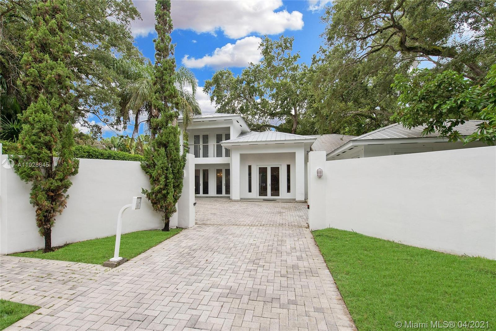 Lovely, walled & gated estate in lush South Coconut Grove. Custom built in 2004 by the current owners. Light-filled, open living spaces w/ wood-beamed vaulted ceilings, stone flooring & french doors throughout that overlook the tropical garden (10,422 SF lot) surrounding the home. Stunning kitchen features wood cabinetry, granite countertops, oversized built-in Subzero refrigerator, gas range & breakfast room. Luxurious master suite w/ sitting area and large bath with soaking tub & frameless glass shower. Ideal layout offers 1st level - 3 BR/2.5 BA (including the master) + office. 2nd level -1BR/1BA + bonus room, easily converted to a 5th BR. Ultra-private outdoor spaces feature covered terrace w/ fireplace & oversized pool for year-round outdoor living. Walk or bike to the village center