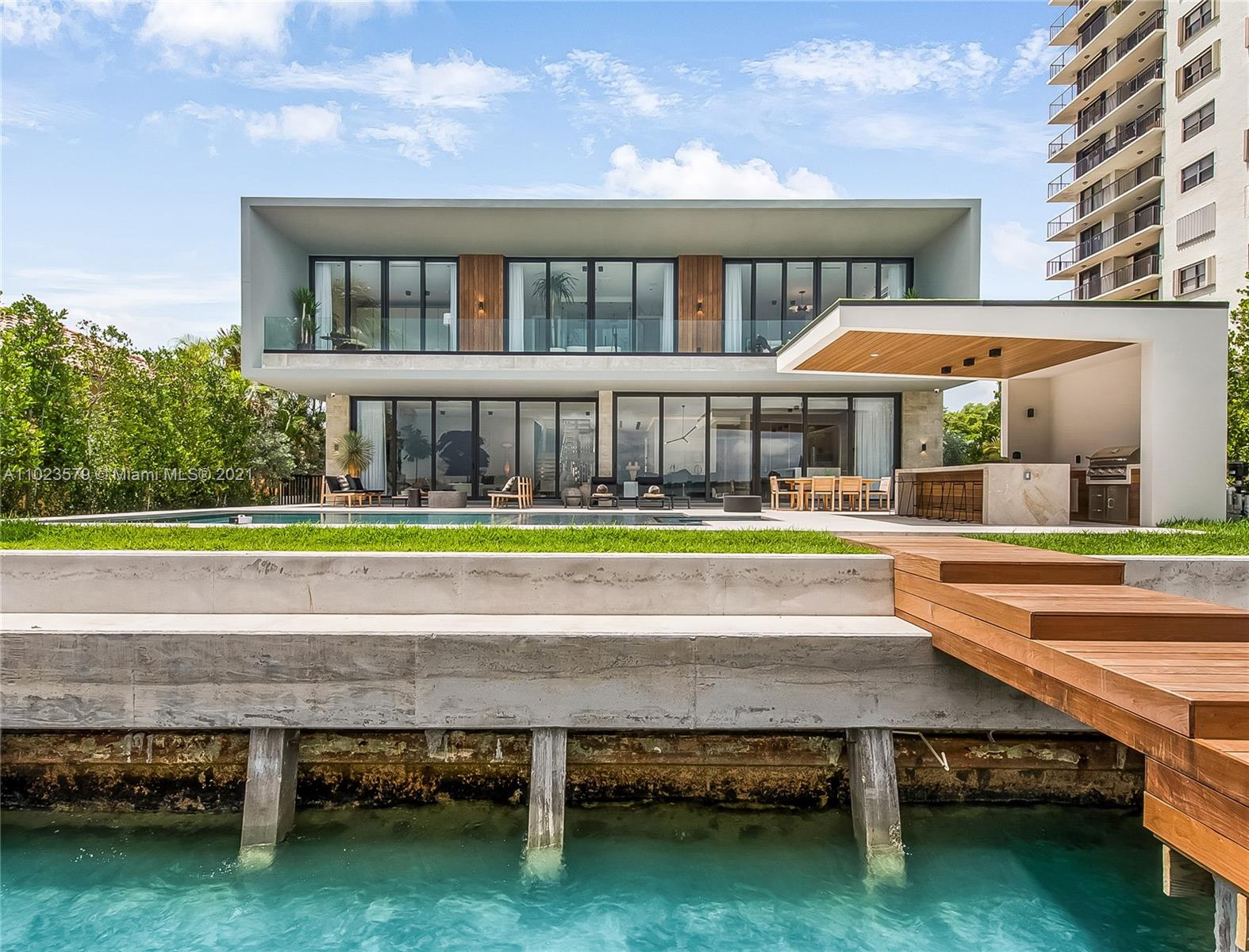 Venetian Islands brand-new waterfront with striking contemporary architecture offering 75 feet of wide bayfront and stunning water and Miami Skyline views! Walk into this dream, 6,400-SF home to find open-concept living areas with Italkraft kitchen, floating staircase, and interior courtyard – all overflown with sunlight and sparkling water views. Excellent floor plan with 2 beds down (guest & maids) and 5 large beds with en-suite baths, walk-in closets, and terraces. Spectacular master suite with lavish bath that will take your breath away! The upper family room is perfect for family gatherings and movie nights. Wood floors, high ceilings, many terraces, music system, security cameras, 2-car garage. Situated on a 11,250-SF lot on residential N Venetian. Fully completed and move-in ready