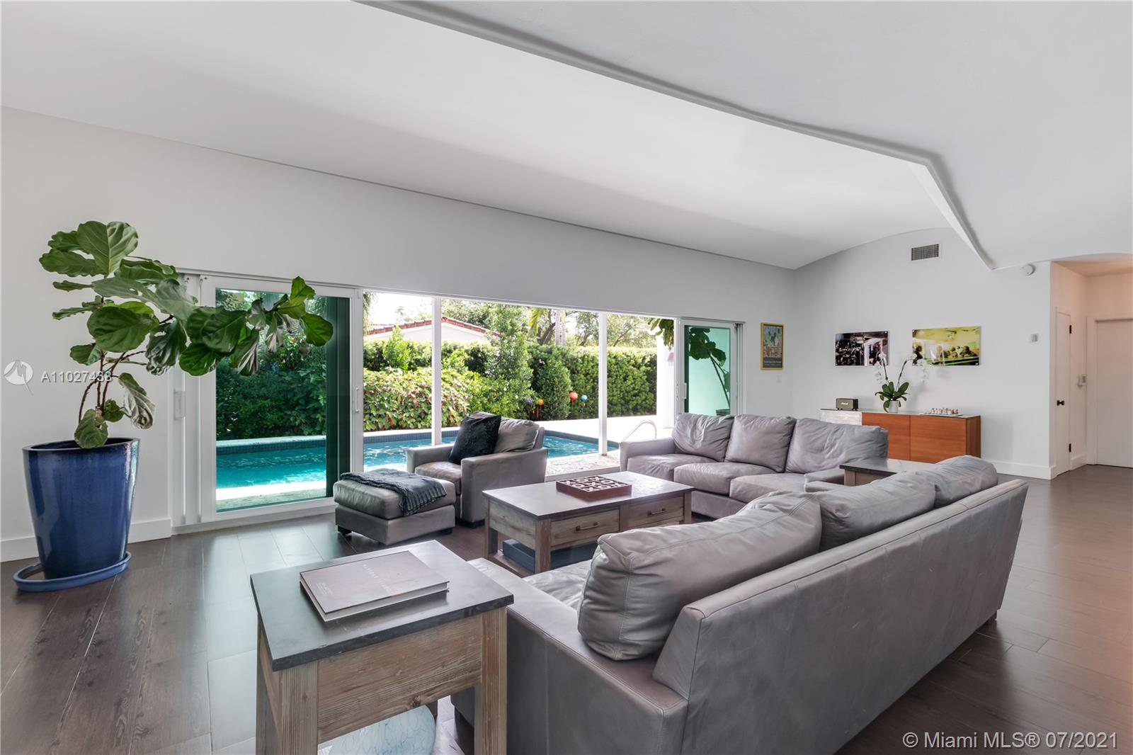 Find your zen in Coconut Grove, a bohemian enclave whose leafy streets and cool ocean breezes have inspired artists and musicians for decades. Newly-renovated and move-in ready, this 4-bed / 3-bath pool home is steps from Biscayne Bay and Sunrise Park - a short bike ride from CocoWalk and South Miami. Features 2-car garage, skylit open kitchen, home office, porcelain floors, hurricane impact glass, and indoor & outdoor dining spaces perfect for families. Master bedroom has a modern bathroom with glass-enclosed shower and large walk-in closet. Cascading glass panels lead to saltwater pool & garden. Minutes to Miami's top public & private schools, marinas, and bike routes. Enjoy poolside BBQs at home or savor Coconut Grove's trendy restaurants, movie theater, farmers market & arts festivals.