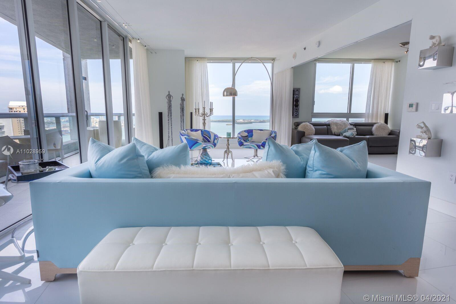 """""""OWNER FINANCING"""". Crown Jewel in Icon 2. Desirable Line D/Corner unit with 1654 sqft on 42nd floor. Spectacular panoramic views of Port of Miami, Miami Beach & Key Biscayne. Luxuriously updated with the finest of features. A 2/2 with beautiful polished white porcelain floors, open concept space & large den/wet bar. Gourmet kitchen featuring exquisite marble tops w/state of the art Wolf appliances. Washer and Dryer in unit and Appliances Warranty Included. 5 Star amenity living with largest eternity pool in all Brickell. 5 Star Restaurants with World Class Icon Brickell Spa & Gym."""