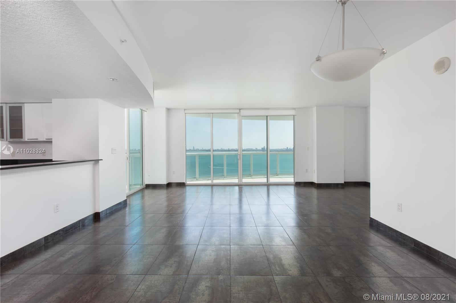 Best line in the building with direct views to the bay and the ocean of South Beach. 3 bedrooms 3 baths with 638Sqft in terraces. Located in front of Margaret Pace Park, close to supermarket, cafes and restaurants. 2 PARKING GARAGES located in the 5th floor. New shower glass and accessories in the three bathrooms, new white cabinetry in the kitchen.