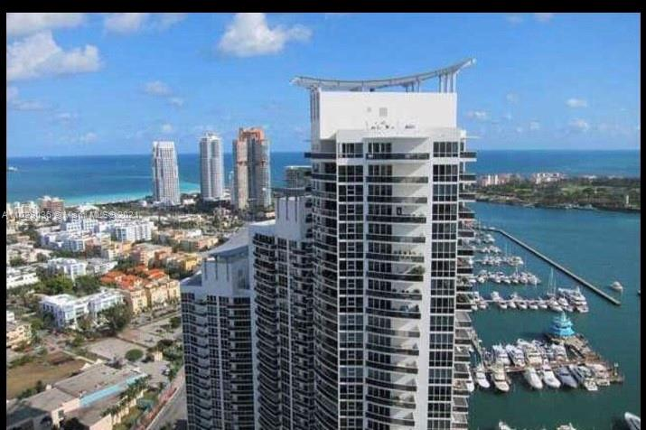 Tenant moving June 30, will be vacant. Marble floors. Granite countertops. Sub Zero appliance. Huge balcony and entertainment area. Semi private elevator. Large living and dining area for entertaining. Best deal at this price range in the area. Owner motivated. Text listing agent for showings. Owner will finance with 35% down payment.  For Boaters Miami Beach Marina with restaurants behind the building.
