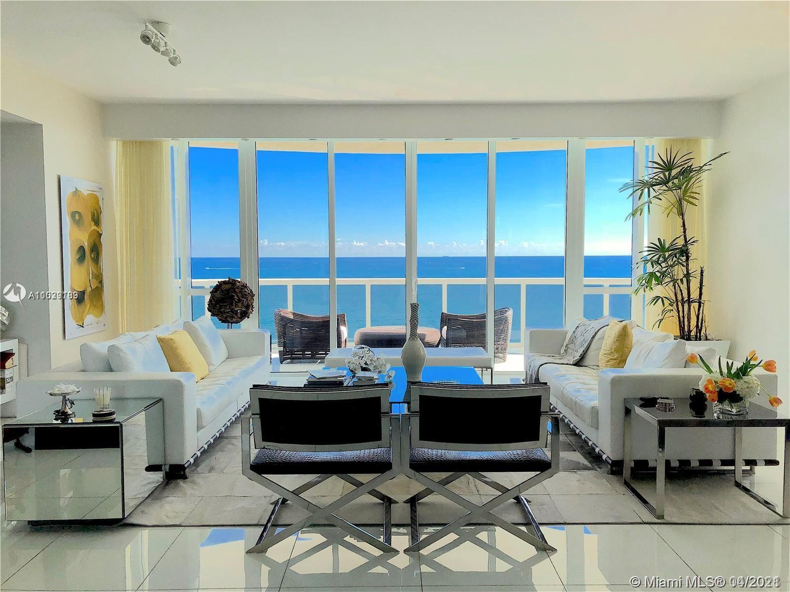 Welcome home. As you exit the private elevator directly into your residence and enjoy the 180-degree views of the ocean. This unit was originally a developer model apartment. Many custom upgrades including custom lighting fixtures, upgraded lighting in all rooms, custom doors, porcelain glass flooring throughout, and upgraded bathrooms featuring TOTO toilets and custom countertops. Listen to the ocean waves from this 01 residence, the largest at Trump Towers, and the only to feature a large wrap-around balcony terrace with a direct east breathtaking view of the ocean. Trump Towers features 5-star amenities including an oceanfront fitness center, spa, full beach service, on-site restaurant, and complimentary valet parking for all residents and guests. Let us show you your future home today.