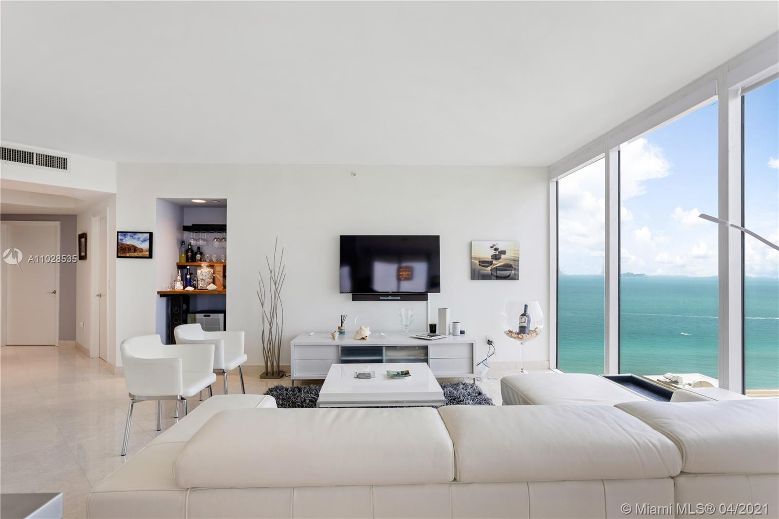 Located in one of the most desirable lines in the building, this southwest corner residence offers 2 bedrooms & 2 baths. Highlighting the home are gorgeous panoramic views of the ocean, bay & Miami skyline. The main bedroom is complete with a spacious custom-built, walk-in closet and a large bath outfitted with double sinks  Jacuzzi & separate shower. Other features include electric shades, modern lighting fixtures, beautiful floors throughout, large wrap-around balcony & exquisite details throughout this residence. The Green Diamond is a luxury Miami Beach condo situated on the ocean, offering extraordinary amenities & services.