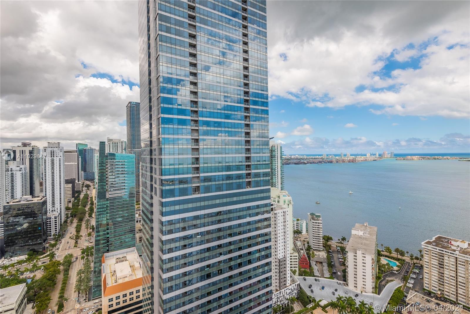 This home in the sky features panoramic water and city views, iHome technology, marble flooring, Sub-Zero and Wolf appliances, built-in coffee & espresso machine and custom Italian cabinets. The building amenities include state- of-the-art 2,800 sq ft. fitness and spa overlooking pool, bay and downtown. It doesn't stop there, room service from the pool side restaurant and dog-sitter/walker too. Luxury lifestyle Miami style!