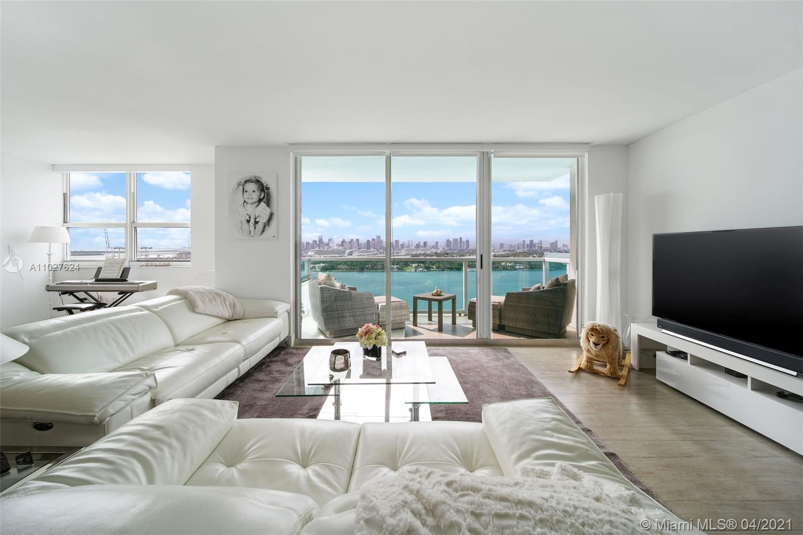 Enjoy breathtaking direct bay views of the Downtown Miami Skyline and amazing sunsets from this redesigned residence at The Floridian.  This fully remodeled 3 bedroom layout was converted to a large 2/2 with over 1400SqFt.  Delight in a larger living space with lots of windows.  The kitchen has also been reconfigured allowing for a more open cooking space with a separate dining area for entertaining.  The main bedroom is features a walk-in closet and modern en-suite bath with double vanity.  Bidet too.  The 2nd bedroom also features and en-suite bath and tub.  Custom lighting, in unit, full size washer and dryer and 2 parking spots in the garage are some other highlights to this unit.  Live at The Floridian, a luxury bay front building with resort like amenities and an ideal location.