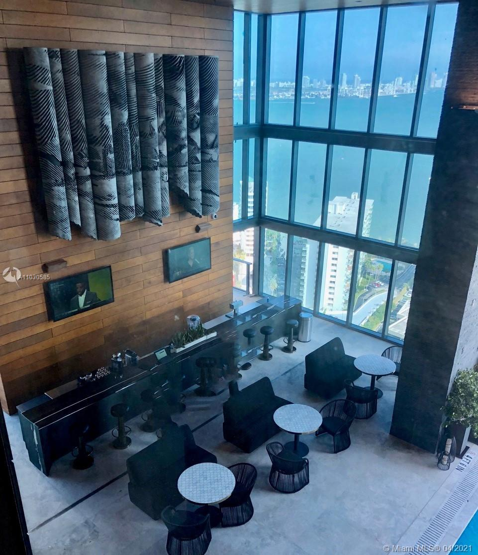 SEE YOURSELF LIVING AT THIS BEAUTIFUL AND LUXURIOUS CORNER UNIT. 2 BED/2.5 BATHROOM WITH AMAZING VIEWS OF THE BAY AND THE CITY . EUROPEAN KITCHEN CABINETRY, TOP OF THE LINE KITCHEN APPLIANCES. MOTORIZED SHADES THROUGHOUT. SUMMER KITCHEN BOUTIQUE RESIDENTIAL BUILDING. ENJOY ITS GREAT AMENITIES, STATE OF THE ART GYM EQUIPMENT, POOL, CONCIEREGE 24/7, VALET, ELECTRIC CAR CHARGING STATION... WALKING DISTANCE FROM RESTUARANTS.. CAFETERIAS. SUPERMARKET, NIGHT CLUBS, METRO MOOVER AND MORE!!! CLOSE TO I-95/KEY BISCAYNE. TENANT OCCUPIED W/60 DAY NOTICE.