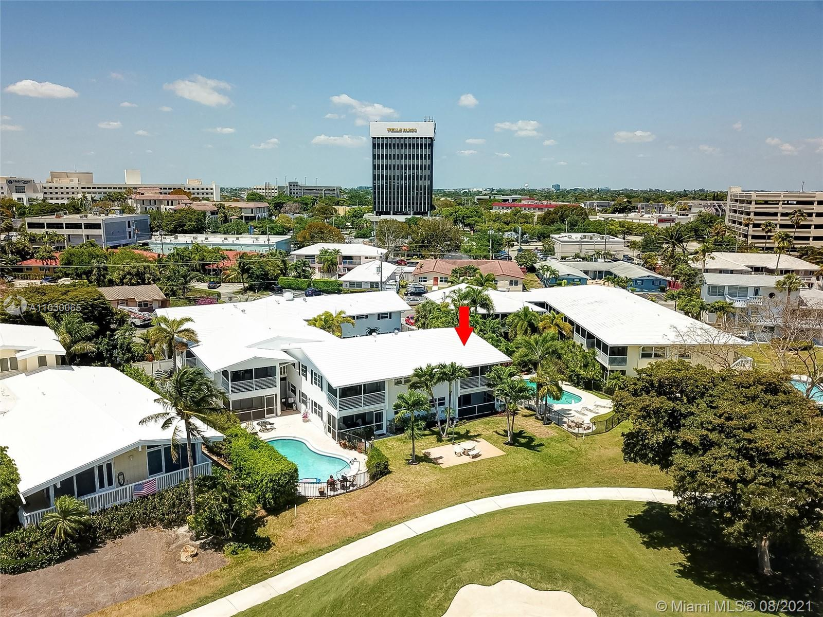 Incredible opportunity to own this gorgeous condo in the heart of Fort Lauderdale on the Coral Ridge Golf Course. Tastefully updated throughout with hardwood floors, and granite countertops in the kitchen. Impact windows throughout! Sit out on your incredible screened balcony overlooking the golf course and lake. The bathrooms were turned into one large bathroom that has access for both rooms. This building is a classic and only features 12 units total. It has an awesome pool and bbq/picnic area. Do not miss out! All ages welcome!