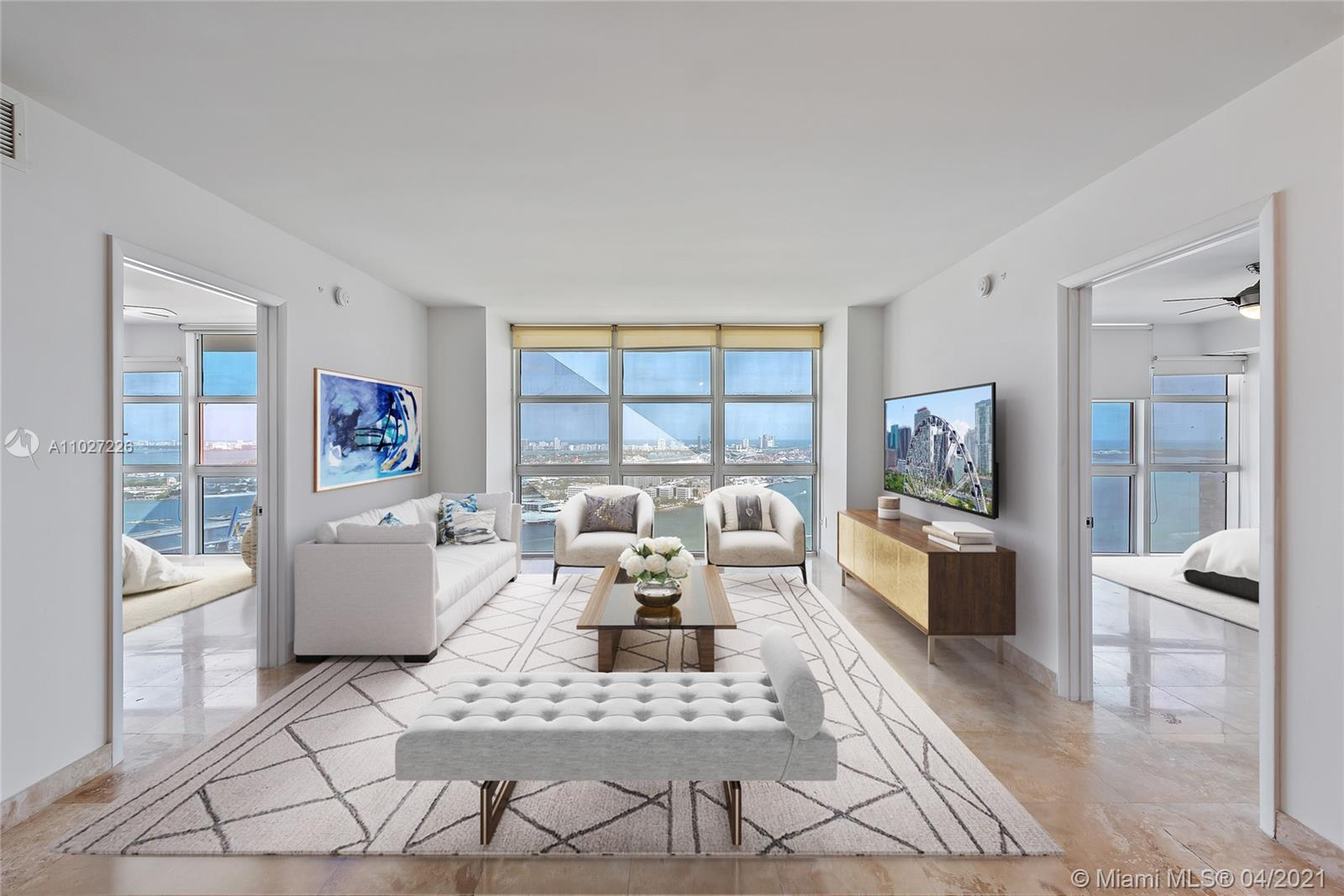 A metropolitan oasis at 50 Biscayne! Residence 4106 features 2 bedrooms + den, 2 baths, travertine floors throughout, and a kitchen with all Teak cabinetry. The living room and bedrooms provide unobstructed, magical views of Biscayne Bay and Bayfront Park. In lieu of a balcony, exterior window art inspired by Roberto Burle Marx lets residents see the bay through the lens of his work. 50 Biscayne residents enjoy a 2-story clubroom, infinity-edge pool deck w/ cabanas and lush landscaping, and a 2-story health + fitness center containing a spa and meditation rooms. Located in Miami's lifestyle epicenter, walking to the arts + culture nearby such as Bayside Marketplace, Perez Art Museum, and AAA has never been easier.