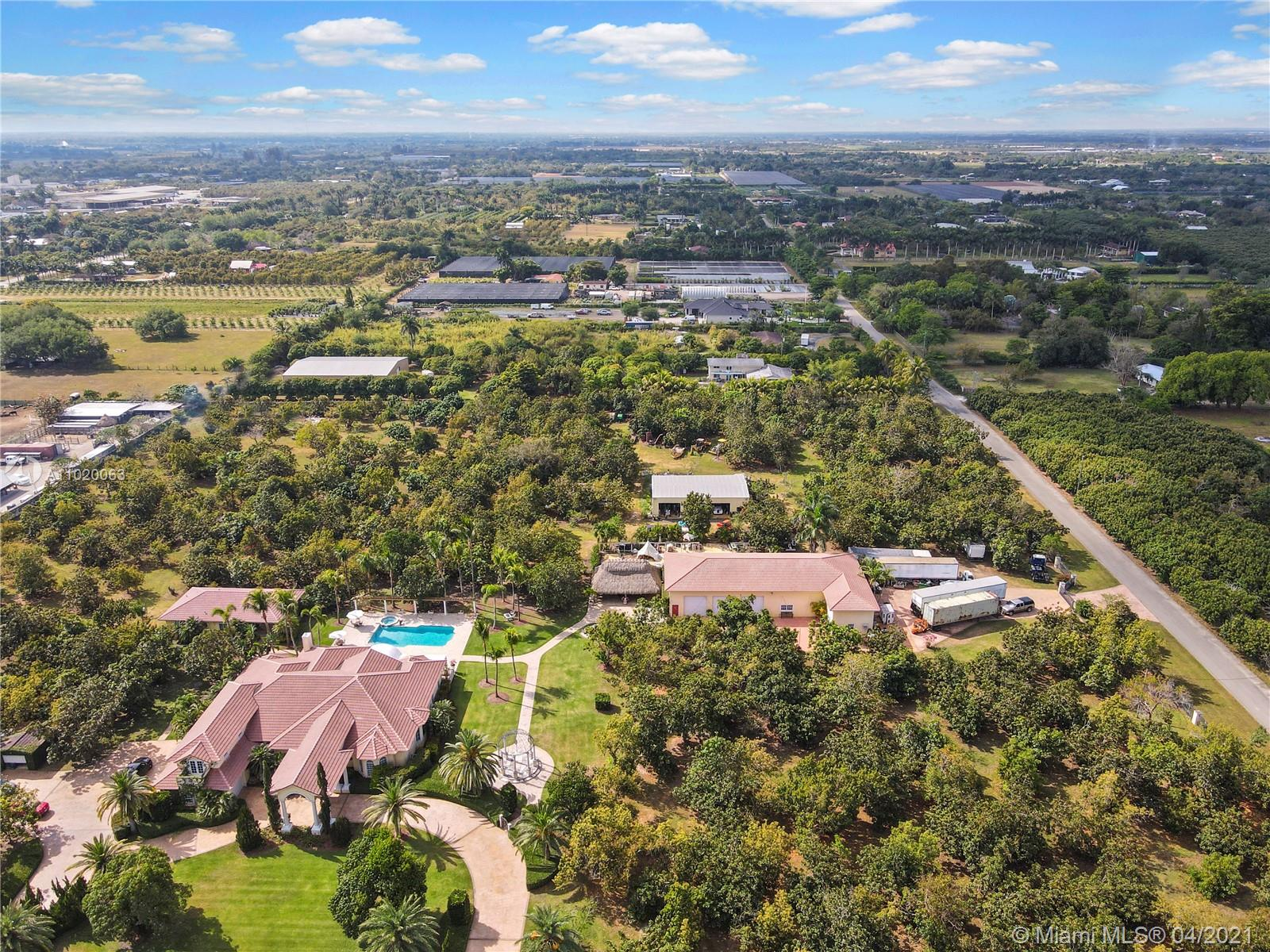 """VIA BELLA ( A-BEAUTIFUL PATHWAY) IS A LUXURY 10 ACRE ESTATE IN """"THE HEART OF REDLAND"""".THE NAME REFLECTS THE PROPERTY. SHES A  6/5, WITH AN AIR OF FRENCH COUNTRY.  A LARGE VERANDA OVERLOOKS THIS RESORT LEVEL POOL AND PATIO, 1 OF 2 GARAGES IS A ATT 3 CAR. THE POOL HOUSE IS A 2/1.5 WITH A 'WIDE  PATIO ALSO OVERLOOKING THE GROUNDS & POOL. THIS IS A VILLAGE, STROLL THE MEANDERING PATHWAYS TO THE 12+ CAR GARAGE WITH OFFICE, TO THE TIKI STYLE PARTY PAVILLION PAST THE FIRE PIT,GAZEBOS,LAWN ART,ETC. THE BACK ACREAGE IS  AN IRRIGATED GROVE INCLUDING MOSTLY MAMAY, AVOCADO, MANGO, ANON, CHITYMOYA & GUANABANA.  CUSTOM BUILT BY HARRIS/SCHRADER WITH POURED CONCRETE CELLS. SHES FULLY FENCED WITH MULTIPLE IRON GATES , LUSHLY LANDSCAPING,SECURITY NO EXPENSE WAS SPARED OR OVERLOOKED. AGRI EXEMPT"""