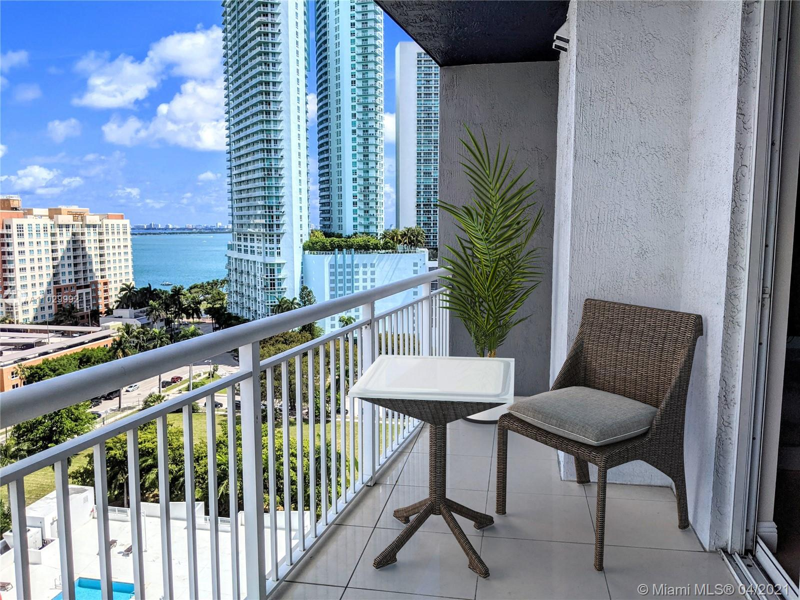 Enjoy beautiful sunrises and sunsets from this 2 bedroom, 2 bath corner unit. Intracoastal and city views through the floor to ceiling bay windows, tile floor throughout, open kitchen with granite countertops, washer and dryer inside unit. 1 assigned covered parking space. 1800 Biscayne Plaza has a modern lobby, fantastic pool area and fully equipped gym, and 24 hour security. Located in the new upcoming area of Edgewater. Close to the performance arts, American Airlines Arena, Bayside, the Art District and a few blocks from Downtown Miami!