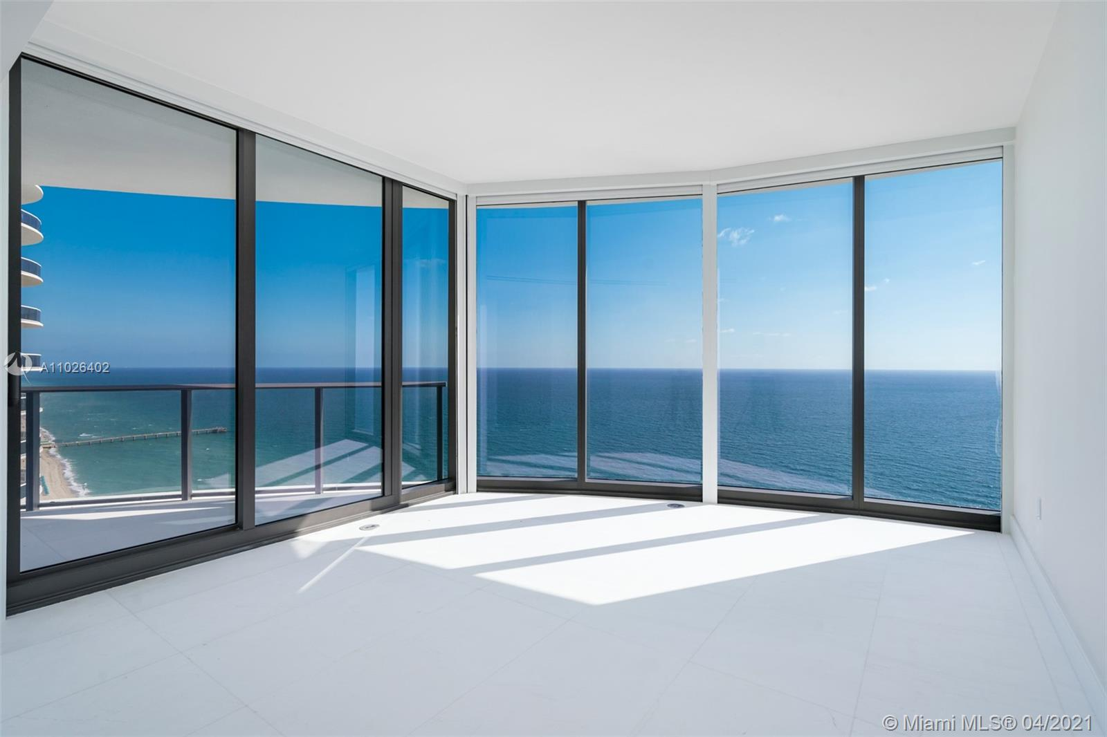 Spectacular wrap around,  This 3 Bed +Den + Staff Room corner residence with floor-to-ceiling glass windows offers direct ocean and flow-through views and plenty of natural light! The den is unique in that it has windows and connects to a bathroom, making it a very versatile space for owners to enjoy as a family room, office, dining room or even a 4th bedroom.  Ritz Carlton manages with the brand, all within the privacy of an entirely residential building.  Owners will experience  5* star services throughout this resort making this the ultimate vacation home.  Fully finished ready to move in,  Ritz includes a full arrange of amenities, gym, spa, hair salon, private treatment rooms, kids club, pool bar and restaurant.