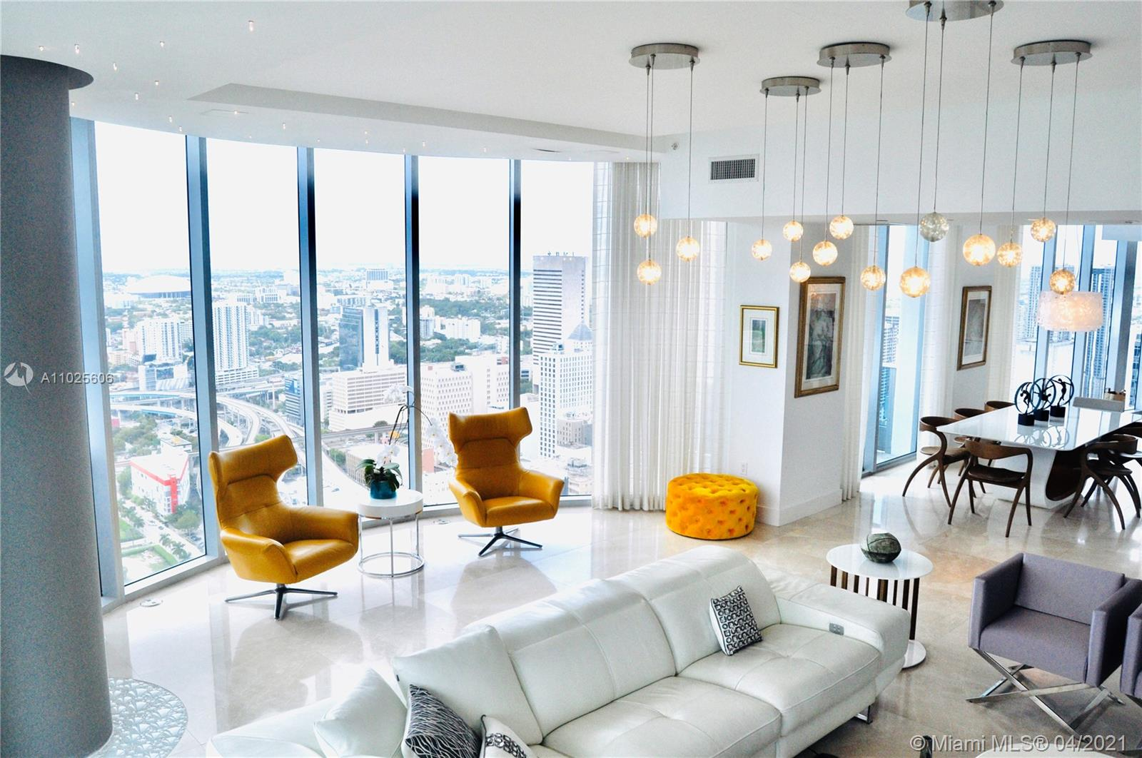 South East corner 52nd floor penthouse, unobstructed view, 2,457 ft2 livng area + 597 ft2 terrace, + 2 balconies, 4 garage pkng spaces, unobstructed views of bay, ocean, river and city! Across from Whole Foods and Silverspot Cinemas! Near banks, schools, Post office, restaurants, coffee shops, shopping centers, American Arena, Brickell City Center, and hotels! Short drive to Miami Beach, airport, golf courses, Marlins Park. Unit has marble floors, electrical window treatments, wind resistant windows, white kitchen cabinets, standard storage space + additional private storage room. Enjoy residents and hotel amenities such as 5 pools, gym, spa, yoga room, 24/7 concierge valet parking for guests and extra cars, 24 hours security, 2 restaurants including Zuma, in room dining, and more!