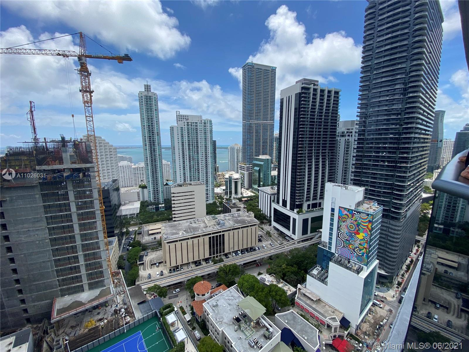 Practically new beautiful 31th floor unit with amazing ocean and city views, large bedroom + den, 2 full bathrooms, terrace, top of the line kitchen appliances, breathtaking amenities such as 3 pools (one at the 50th floor roof with 360 ocean and city views of Miami), gym, 2 clubrooms, movie room, kids room, spa room, conference room and putting green! Best location in Brickell across  from Publix and Brickell City Center! Walk to schools banks restaurants coffee shops! Great for investors: unit rents for aprox $2850 monthly