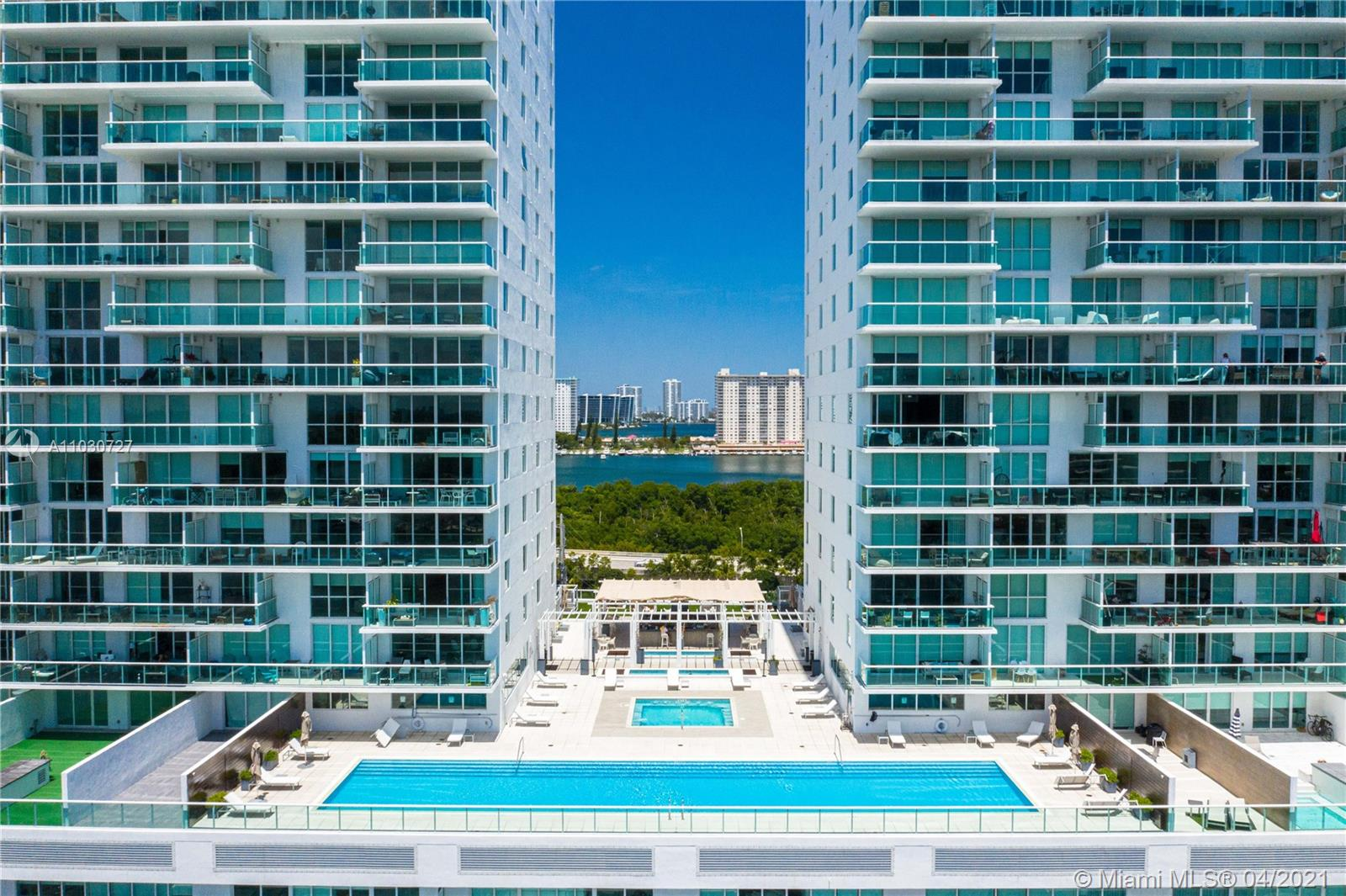 VISUALLY STUNNING DESIGNER UNIT IN A PREMIER WATERFRONT PROPERTY. FEATURES INCLUDE- 180 DEGREE INTRACOASTAL WATERVIEWS & OLETA PARK, GLASS ENCLOSED 3RD BEDROOM OFF THE KITCHEN PLUS A 2 STORY OPEN BALCONY ENHANCING MUCH LIGHT INTO LIVING AREAS. APT IS SPLIT LEVEL (2FLS) WITH EUROPEAN CABINETRY & APPLIANCES WITH DESIGNER FIXTURES THRU-OUT,  SPACIOUS CLOSETS, WASHER/DRYER IN UNIT, 2 PARKING SPOTS,  400 SUNNY ISLES IS A FULL-SERVICE CONDOMINIUM WITH AMENITIES SUCH AS OLYMPIC SIZED INFINITY EDGE POOL, CABANAS, 24 HR CONCIERGE & VALET, PRO TENNIS COURTS AND FITNESS CENTER.