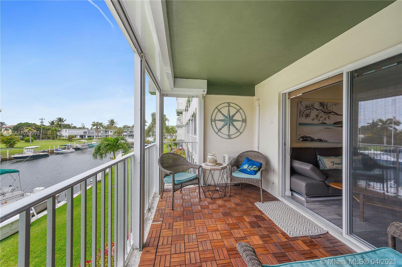 2 bedroom, 2 bath condo with covered balcony & view of the inlet and pool. Unit has been fully renovated in 2018, kitchen has a built-in kegerator. This is a vacation home used a couple times a year, very well maintained. The building is tucked back amongst a neighborhood of single family homes for added privacy & exclusivity, & features 2 private pools, putting green, shuffleboard, elevator & common laundry. Full hurricane protection with electric shutters. Centrally located within minutes to Deerfield Beach, shops & restaurants & all of your in-town needs, including Target!