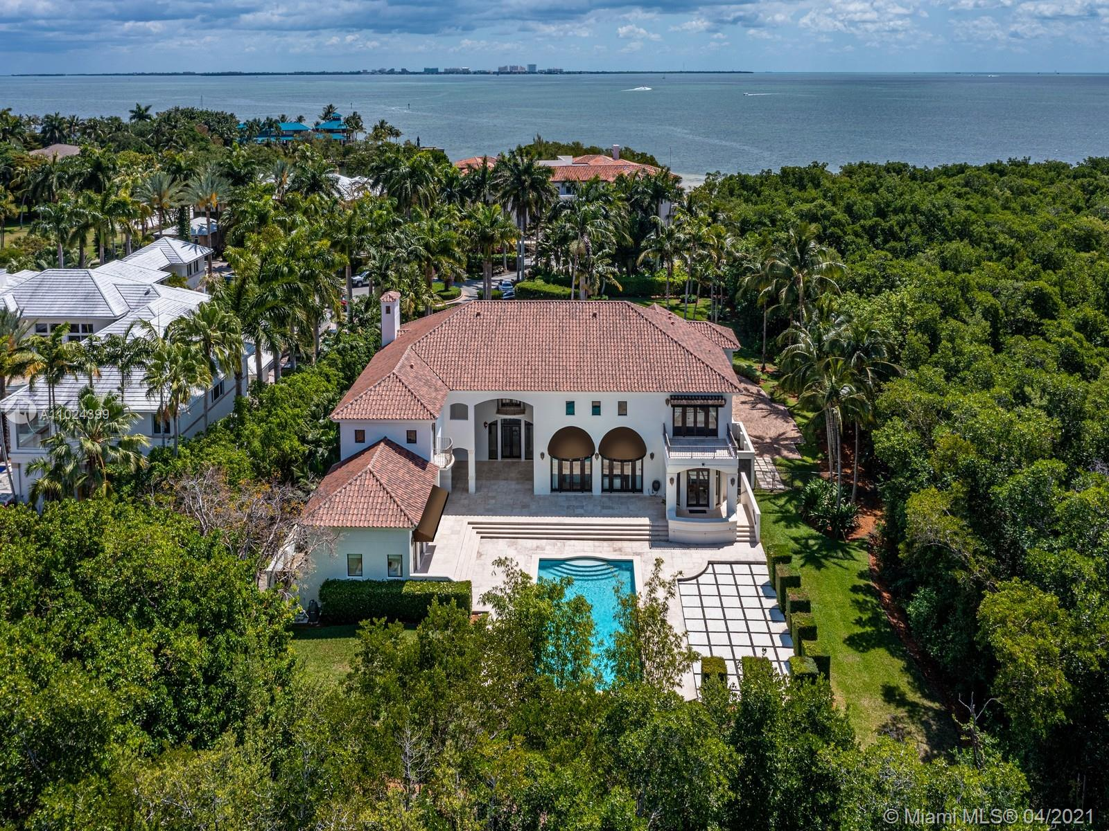 Located behind the gates of Tahiti Beach,one of Miami's most exclusive communities in Coral Gables this stunning Mediterranean estate is ideally located at the end of a private cul-de-sac.Offering a lush LOT OVER ONE ACRE.This home features 10,768 SF Total,7 beds,6.5 baths,a double-height foyer&family room, oversized master bedroom w/a large balcony+a guest house w/a full guest house.W/a large pool&extensive outside terraces,perfect for entertaining. Large kitchen with a butler's pantry.Including a large office w/ a full bath and balcony,3 car garage,service room,impact windows throughout&recently updated roof.Don't miss this incredible opportunity to live in one of 26 homes in this private community,complete with a private beach, tennis courts &access to all Cocoplum amenities.