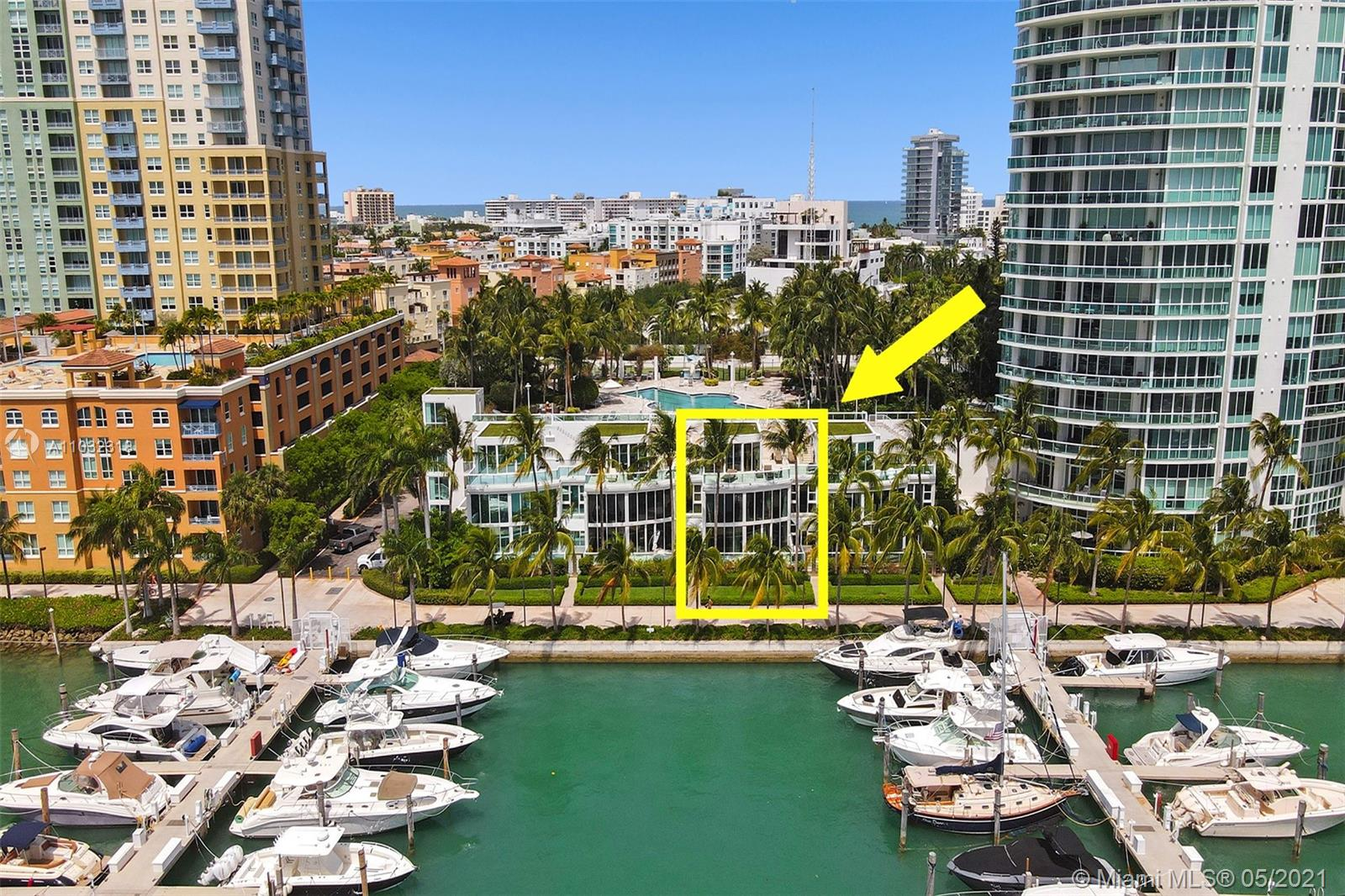 Old World Elegance! Largest, Waterfront Townhouse in prestigious South of Fifth located in South Beach. This waterfront TH is a rare jewel reminiscent of Italian Versace style grandeur. Feels like living in a villa in the South of France w/ the benefits of a luxury condo. A boater's dream! Dock your yacht steps away! Best positioned TH allowing for unobstructed views of mega yachts, bay, Miami skyline, & Fisher Island. Artisans & Craftsmen created a work of art w/ highest quality finishes incl. Hand Carved Marble from Rome, Italy, luxurious open kitchen, ONYX baths, grand private master suite w/ tons of closets. Over $1 Million spent! 3,386SF per owner, Gated double door entry, huge private terraces, Multi-level, High ceilings, direct access to the Murano at Portofino 5-Star Amenities.