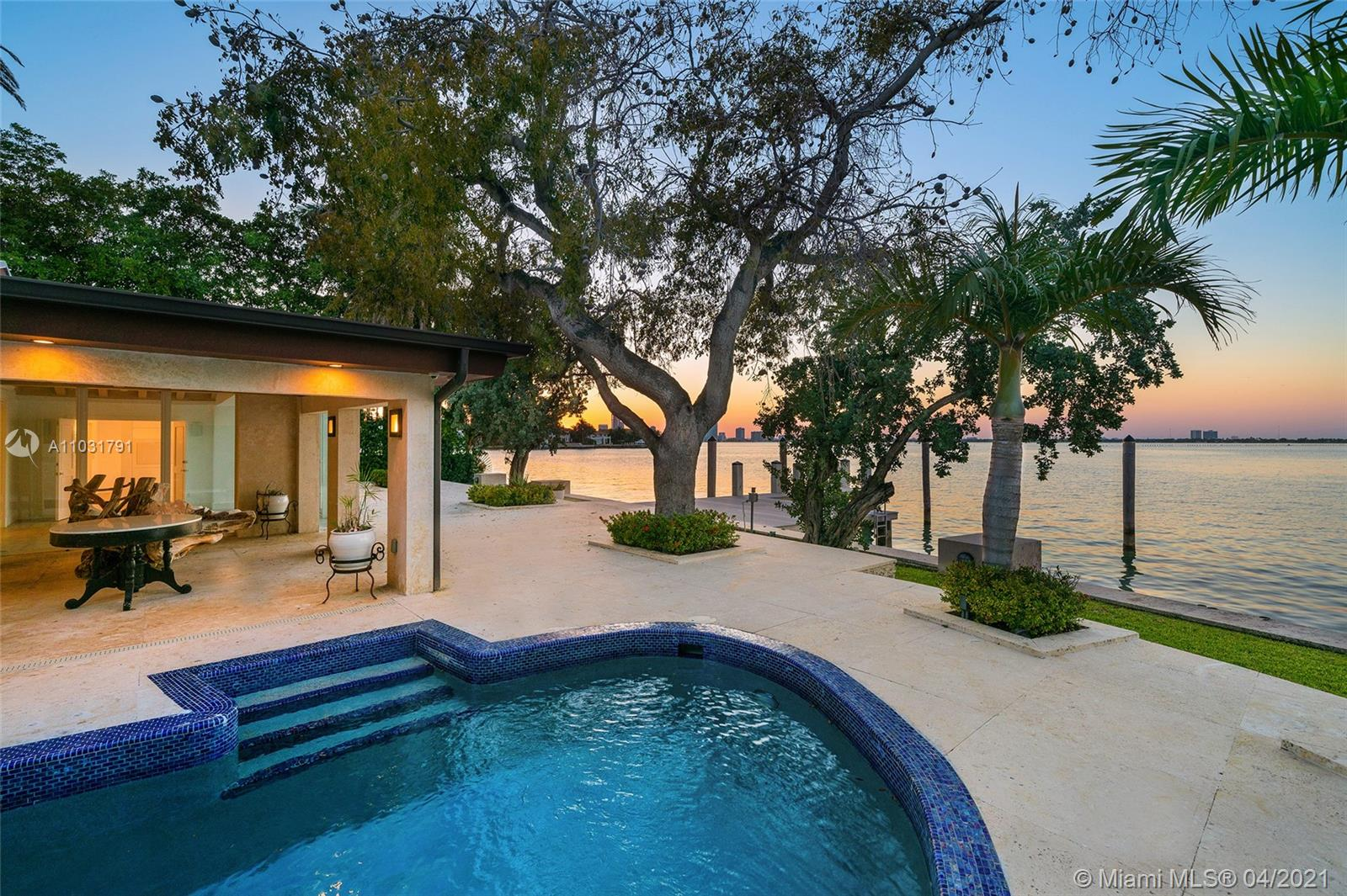 This Bayfront home is perfectly located on the coveted tip of the Venetian Islands. The 5BR/5BA home sits on a 13,382 SF lot w/open Biscayne Bay & stunning sunset views. Over 4,800 interior SF, wide plank tan oak & custom Cuban tile floors, high wood-beamed ceilings, sky lights & an interior courtyard. Spacious living room w/fireplace & wet bar, family room w/full BA, & dining room all w/large windows & water views. Gourmet kitchen sports top-of-the-line Wolf & Samsung appliances, granite center island, eat-in seating & adjacent family area to relax. Bay facing principal suite offers direct terrace access, voluminous walk-in closet & elegant principal bathroom w/walk-in glass shower & pedestal soaking tub. Large pool, deck w/covered seating area, large dock, direct bay & Ocean access.