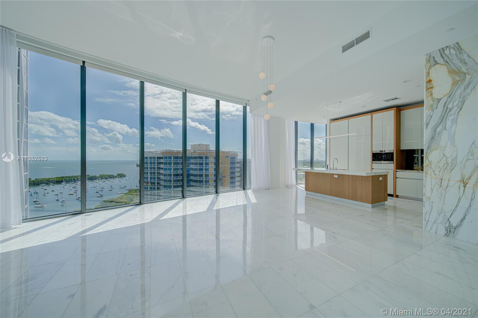 Magnificent bay front condo in Coconut Grove. Featuring a private elevator opening into a keyed foyer, this home offers 4 bedrooms, 5 1/2 baths, marble flooring through-out, 12 Ft floor-to-ceiling windows overlooking Biscayne Bay, custom ItalKraft closets, Subzero & Wolf appliances, and a 440 SqFt terrace. Hotel-like amenities include: 4 pools, cabanas, BBQ. 3D Tour available.