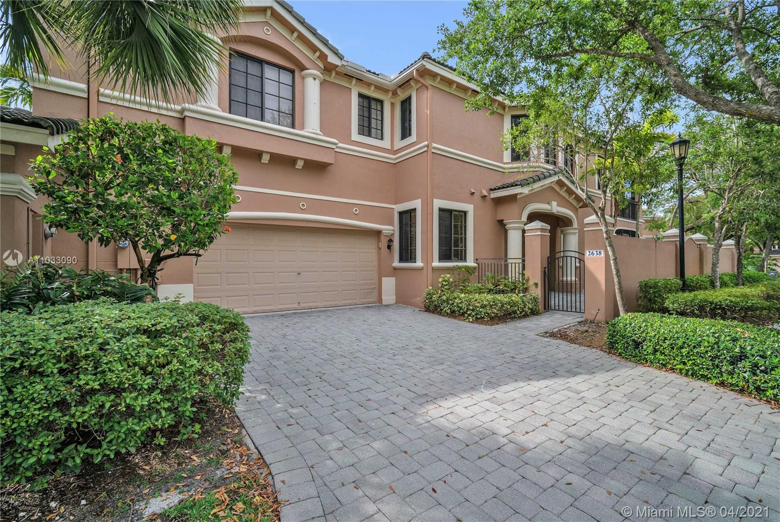 THE GEM OF COURTSIDE.... Best downstairs unit in complex. Corner unit with rare private driveway and 4 additional guest parking spaces inside the exclusive Courtside at Weston Hills Country Club. Enjoy a high-end renovated kitchen with italian custom made cabinets and top of the line Subzero and Jenn-Air appliances ($30k value). Immaculately taken care of, Custom-Made Garage, High Impact Doors, Open Porch, Patio, Privacy Wall, Screened Porch and move in ready. Walking distance to Weston Hills Country Club and Weston Town Center shops and restaurants.