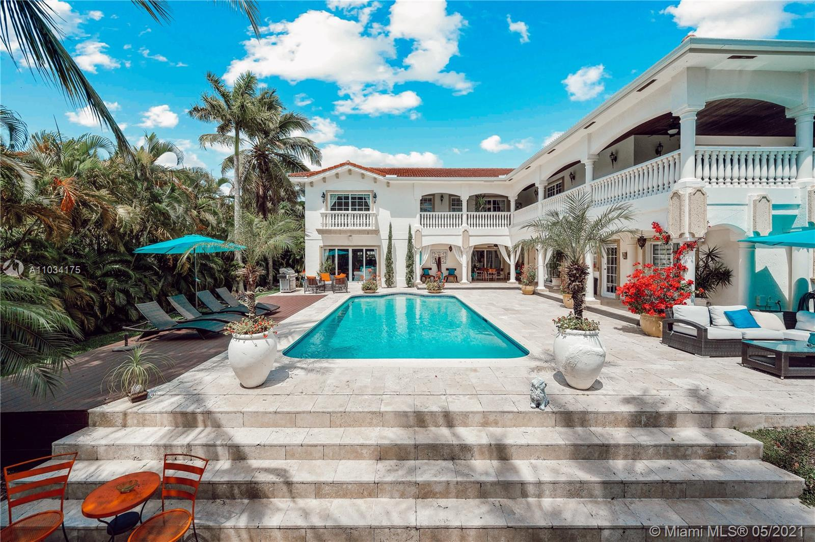 Gorgeous mediterranean style mansion in Golden Isles. Two story waterfront residence with 100 ft. of deep-water frontage. A boaters dream with a wide canal, no fixed bridges, boat & jet ski lifts. Over 6000 sq. ft. of living space, 6 bedrooms, 5/2 bath, 15750 sq. ft. corner lot, outdoor surveillant cameras, 3 new a/c units, palatial private luxurious setting ideal for entertaining, lush, and extensive landscaping, heated pool, fenced and treed, gated community, no association, walking distance to shops, and new amenities filled galore park which is steps away. You will be proud to call this your home. Great as a home or as an Airbnb investment. Furniture and boat are negotiable. MOTIVATED SELLER!