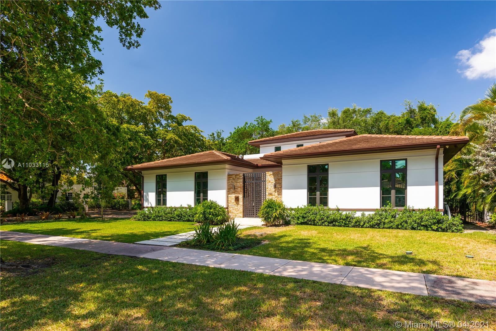 4 bedroom/4 ½ bath with great curb appeal, a summer kitchen, pool and 2 car garage in a great Coral Gables location.