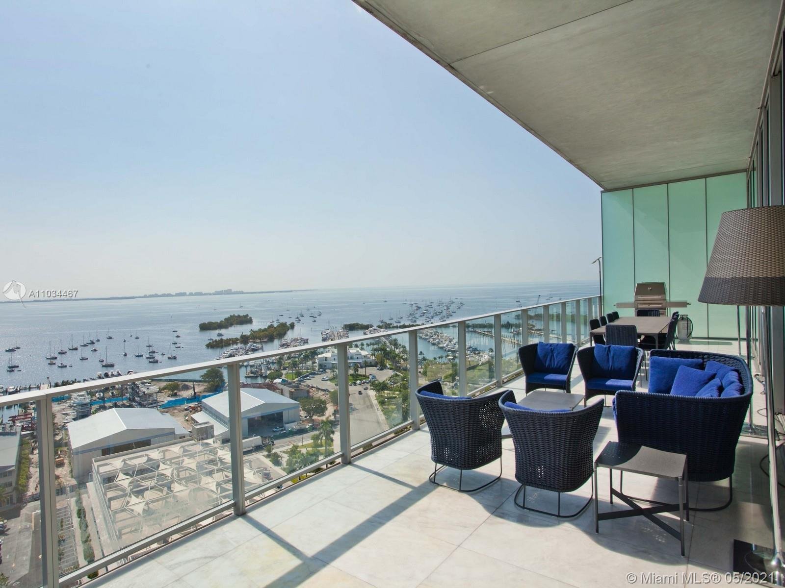 Spectacular Modern luxury condo at the Grove at Grand Bay South Tower in Historic Coconut Grove.  An iconic residence that evokes luxury. Distinctive contemporary design includes 12 foot floor to ceiling glass doors and unobstructed panoramic views of beautiful Biscayne Bay.  This 6 bedroom and 6 1/2 bathrooms unit is one of a kind, including natural light in every room and and open spacious floor plan.  Original finishes from the developer were entirely upgraded to the finest materials and craftsmanship.   Upgraded finishes includes Poggenpohl Kitchen, Sub-Zero Fridge, Freezer and Wine Cooler, Marble Bathroom floor to ceiling, Italian Cabinetry in Bathrooms, Custom Italian Library, Custom Cabinetry in Laundry, Two and half car garage with custom cabinetry and commercial resin flooring.