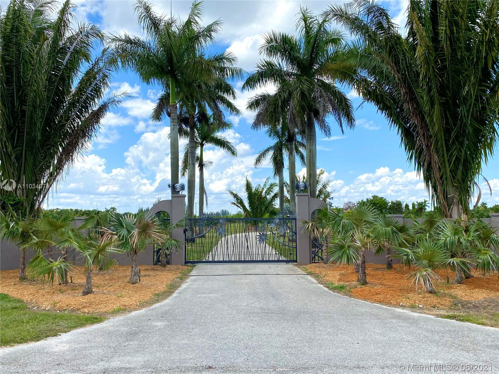 Beautiful Estate property with tropical fruit groves in Redland agricultural area of Miami. 9.03 acres fronting onto SW 280 St (Waldin Dr) west of SW 182 Av (Roberts Rd). Spectacularly finished 3/3.5 residence. Move-in condition. Newly upgraded bathrooms, gourmet kitchen, library/office, exercise room, utility room, 3-car garage, new septic system, new impact windows and doors, large covered patio overlooking lushly landscaped property. 360 mature Longan trees and 281 prized Keitt mango trees with overhead & drip emitter irrigation, pump house with diesel pump & 4 wells. Diesel backup power generator. Fully fenced with electric gate and intercom. AU zoning Flood Zone AH 13' above sea level. Unique income-producing investment opportunity. Minutes to shops, banks, restaurants and Turnpike.
