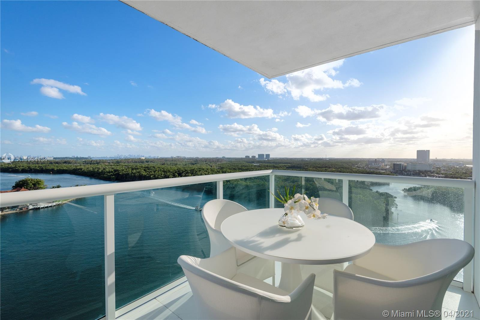 Gorgeous corner unit with Ocean and Intracoastal views featuring floor to ceiling glass windows, impressive views from every room, balcony with glass railings; 3 bedrooms, 3 bathrooms, open kitchen with European cabinetry, SS appliances, white porcelain floors throughout. Fully furnished-Professionally decorated by Artefacto Miami; Electric remote control shades; Washer/dryer in-unit; Soundproofing between units; 24 hour valet & concierge services. Many amenities: Infinity-edged pool, poolside cabanas; tennis court, fitness center with a full service spa, sauna, steam room and jacuzzi; yacht & beach club with in-house restaurant; private marina with dry/wet dock slips available, watersports activities center with boats, paddleboards, kayaks & jet skis.
