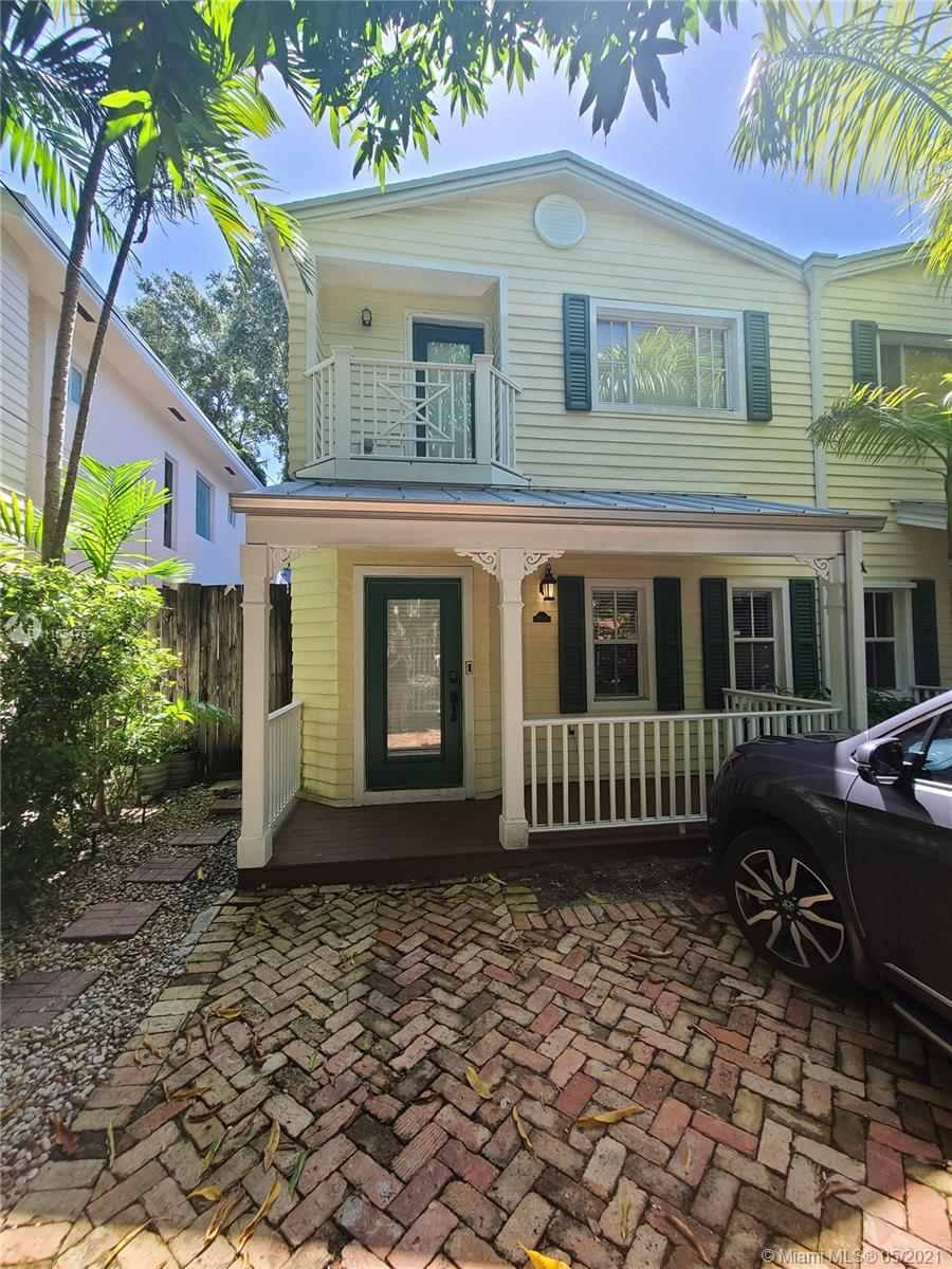 Come live the Coconut Grove dream! LARGER THAN TAXROLL. Beautiful +/- 1,900 SF townhouse located on one of the nicest streets in the Grove. Prime location just steps to shops & restaurants, Kirk Munroe tennis courts, a short walk to Blanche dog park & Kennedy Park, multiple children's parks & zoned for the highly sought Coconut Grove Elementary— which is only 1 block away! This lovely street also has an annual art festival, the Gifford Lane Art Stroll! The home features two master bedrooms, custom-made kitchen cabinets, S/S appliances w/gas range. Working fireplace in the family room. Equipped with 2 NEST thermostats & a ring doorbell. Updated back yard that is beautifully landscaped & partially turfed. Gated parking for 2 cars w/2 add'l spots outside the gate. Roof replaced in 2007.