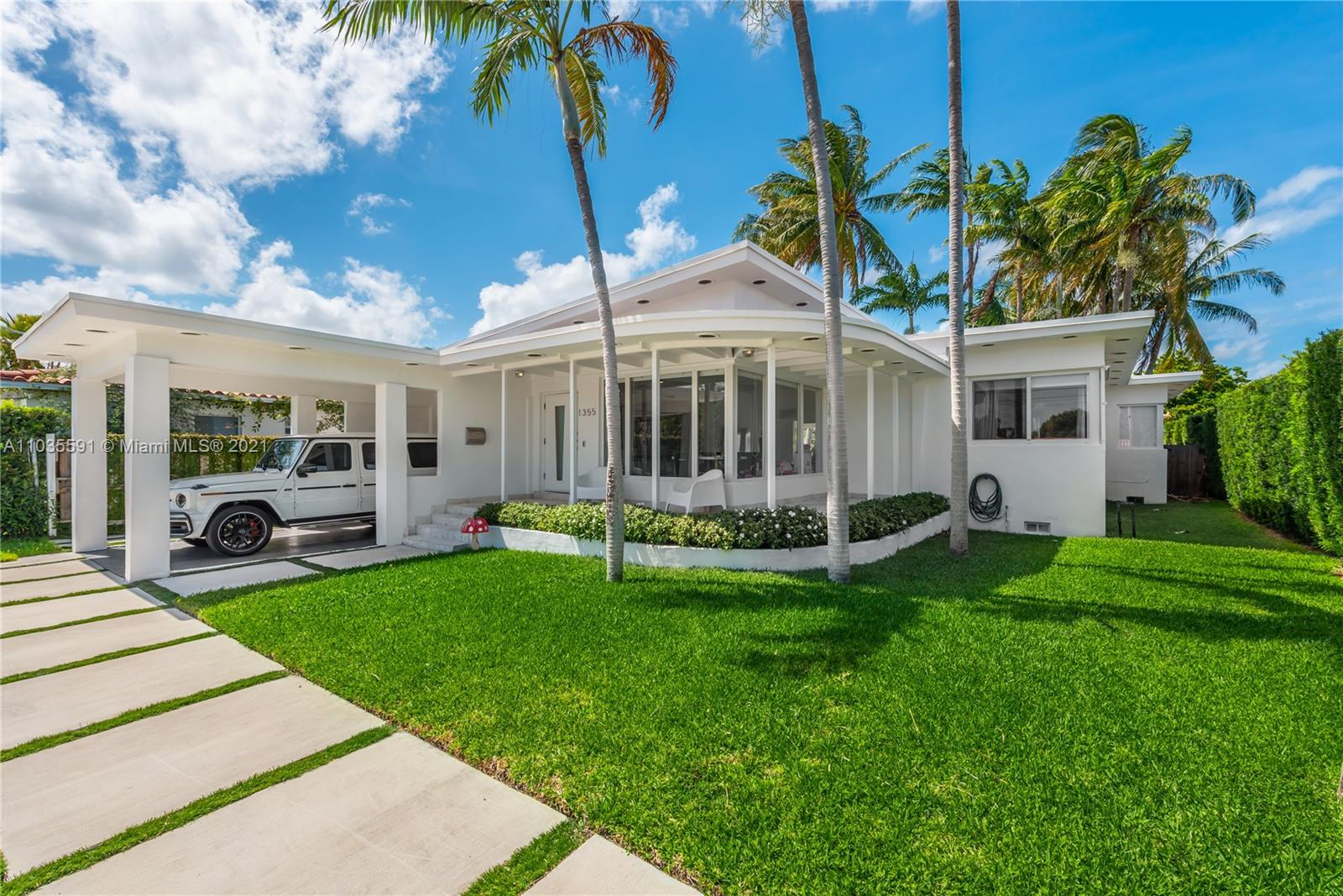 Fully renovated, waterfront, 3 bedroom, 2 bathroom home on private and gated Biscayne Point. Features include: Impact windows and doors, two covered patios, 60 ft of prime waterfrontage, gourmet kitchen, utility/laundry room, 1 covered carport, circular driveway, ample yard space. Excellent location in close proximity to Grade A Schools, beaches, A1A, Bal Harbour, North Beach.