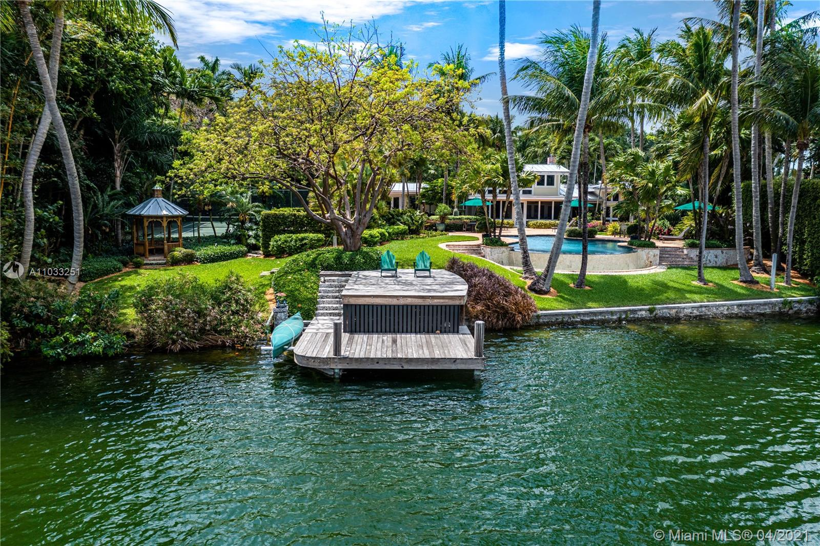 Situated in Hammock Lake, one of the most desirable gated communities in Coral Gables, this gorgeous 6,427 Sq. Ft. home, with 4 BR and 2.5 BA, showcases breathtaking lake views, elegant light-filled living spaces, and resort-like gardens, offering a peaceful and harmonious connection with nature. The home includes a living room with fireplace, formal dining room, and chef's kitchen with walk-in pantry, Wolf and Sub-Zero appliances, and an eat-in island that opens to a gracious sunroom. A charming wood staircase leads from the foyer to the second-floor main suite, with a luxurious bath. Designed for comfortable living, the home also features a theater room with custom-made bar, office, gym, screened-in porch, beautiful infinity pool and tennis court.  A captivating retreat in Coral Gables.