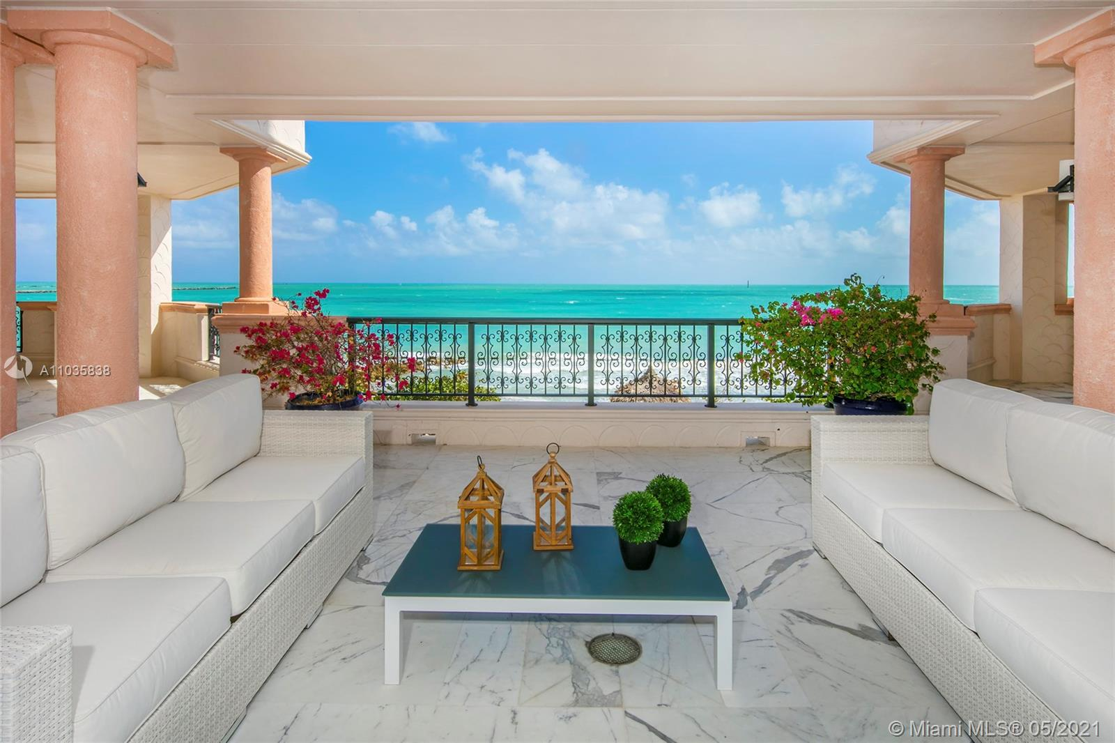 This exclusive oceanfront center stack unit on Fisher Island has a unique privileged location as it is as close to the ocean as you can get, directly in front of the secluded residence beach, enjoying direct unobstructed views to Government Cut & Atlantic Ocean. Unit has an expansive wraparound terrace, spacious open living & family room, gracious dining room & separate breakfast area all w/amazing ocean views. The spacious unit offers 6,820 SF of luxury w/5 oversized bedrooms, 6 +2 BA. One of the oversized bedrooms can be easily converted into a sixth bedroom. The principal suite sports a full office space, separate dual walk-in closets & luxurious dual marble bathrooms. Unit is in good living condition, but it is ideal to be renovated in the near future as it has a clean open floor plan.