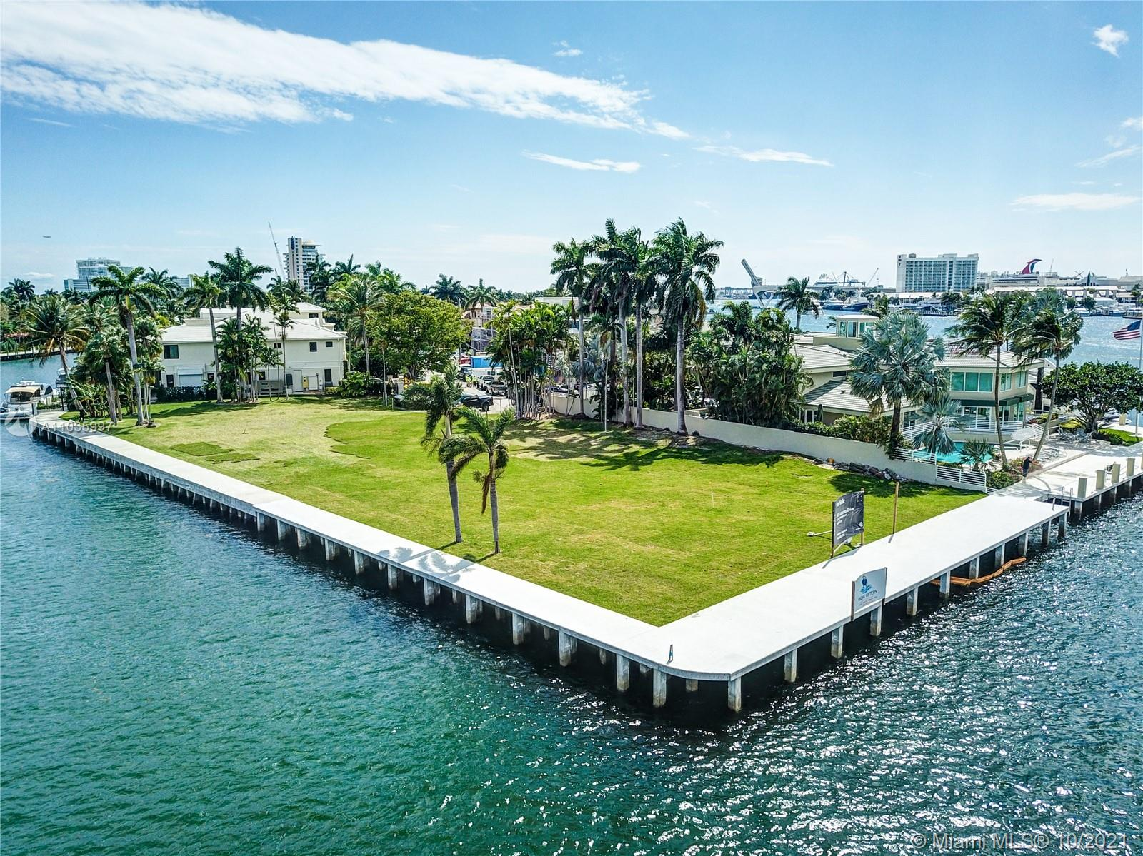 Spectacular Point lot where the intracoastal meets the New River offering panoramic open vistas. Boasting 390+ of water frontage, accommodating large and multi yacht dockage truly just minutes from the ocean. New Seawall and new Dock. Unobstructed views extend far and wide toward the long westward expanse up the New River to downtown Ft Lauderdale. Residents of gated Harbor Beach also have access to the private oceanfront beach club. This oversized lot (29,823 sq ft) located on a very quiet street is ready for a new home. Surrounding homes are in the 19M-25M range so you can easily build a dream home starting with this magnificent piece of property.
