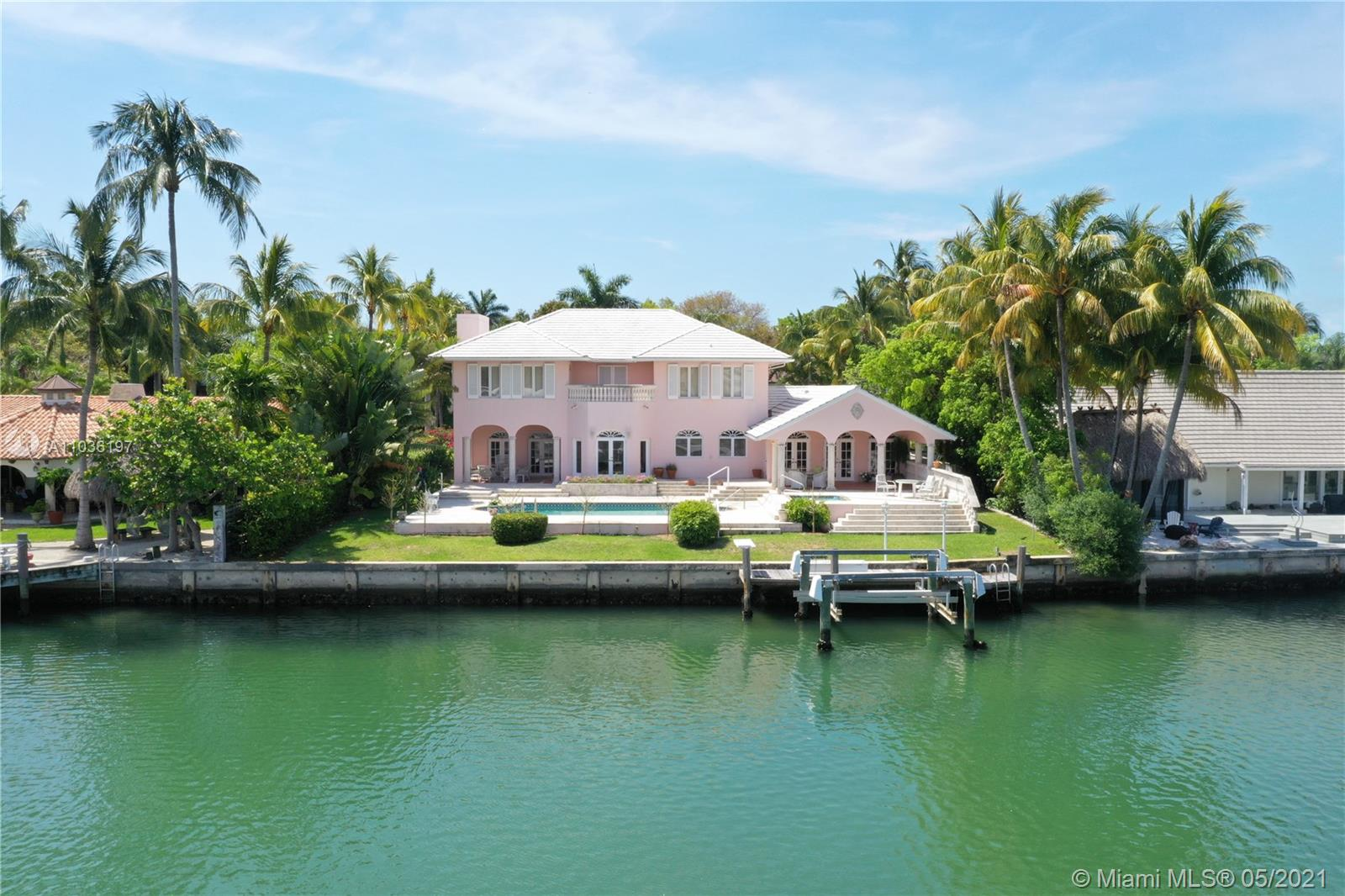 WATERFRONT LIVING ON THE WIDE PART OF THE CANAL. THIS ELEVATED HOME WAS CUSTOM BUILT BY AND FOR THE MACKLE FAMILY IN 1989. THREE OVERSIZED BEDROOMS AND THREE AND 1/2 BATHS. HIGH CEILING THROUGHOUT. TWO CAR GARAGE, FORMAL LIVING ROOM, FORMAL DINING ROOM, FAMILY ROOM AND HUGE EAT IN KITCHEN. SPACIOUS POOL AND PATIO AREA OVERLOOKING WIDE BOAT TURNING BASIN. DOCK AND BOAT LIFT.