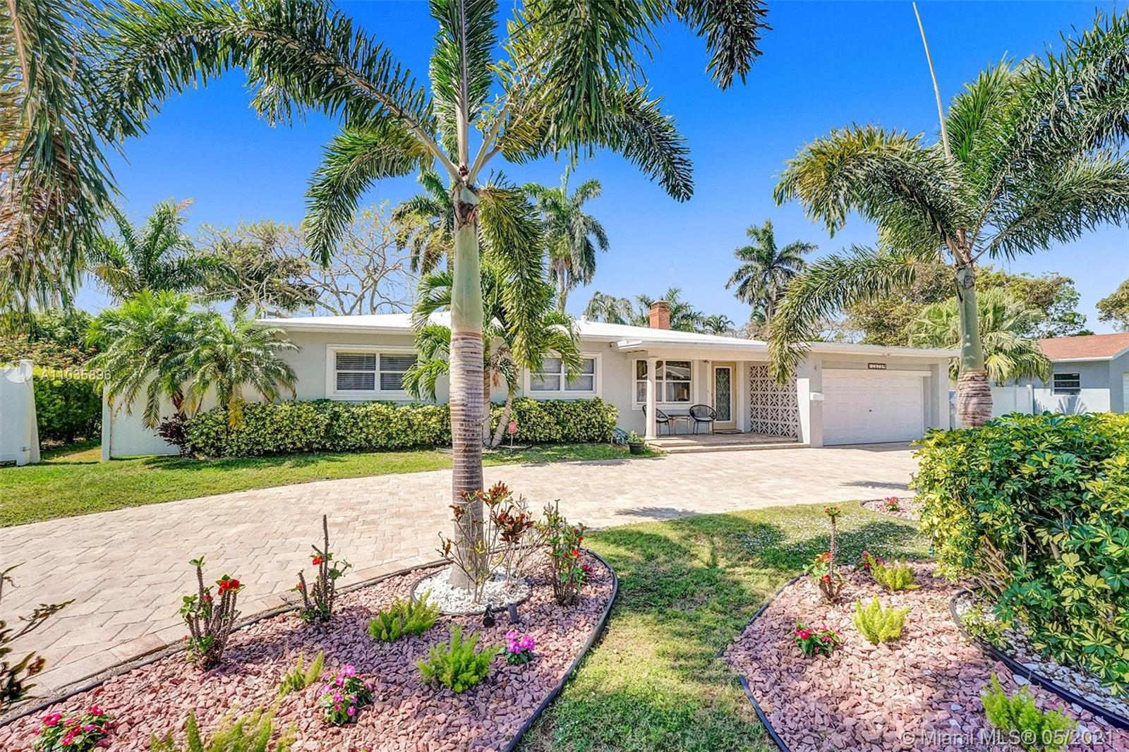 DESIRABLE EAST OF FEDERAL NEAR SHOPS, RESTURANTS AND MUCH MORE, ONLY 1.5 MILES TO THE BEACH. THIS UPGRADED HOME HAS A BEAUTIFUL PAVER CIRCULAR DRIVE THAT WILL PARK UP TO FIVE CARS PLUS A HUGE TWO CAR GARAGE. FRONT DOOR IS IMPACT, WINDOWS ARE SHUTTER READY AND ALL ARE STORED IN GARAGE AND TILE THROUGHOUT. A TWO SIDED FIREPLACE FROM DINING TO FAMILY ROOM. INCREDIBLE BACK YARD, LOT NEARLY 15000 SQ FT. SELLER CLAIMS LEGALLY ADDED FAMILY ROOM INCREASED HOME'S LIVING SPACE TO OVER 1600 SQ FT. THIS HOME IS A MUST TO SEE AND PRICED TO SELL.