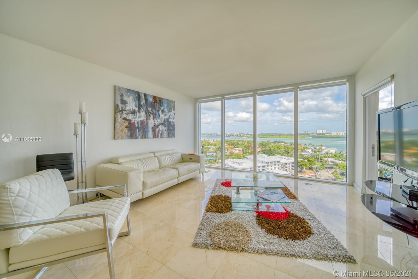 Luxurious, very bright 1 bed/1.5 bath condo located in an oceanfront 5 star luxury building in Bal Harbour.  Marble floors, modern kitchen/bathrooms, open balcony with spectacular unobstructed views of the intracoastal/bay/Bal Harbour & floor to ceiling hurricane windows so you can enjoy the view from inside the living area as well.  Building features full service spa, state of the art fitness center, cafe/restaurant, 24 hour security, valet parking, beautiful pool, direct beach access offering beach service for residents & more.  Building rental policy allows 6 month rentals which makes this a great primary residence, investment property or vacation condo enabling the owner to rent for half of the year to offset costs.