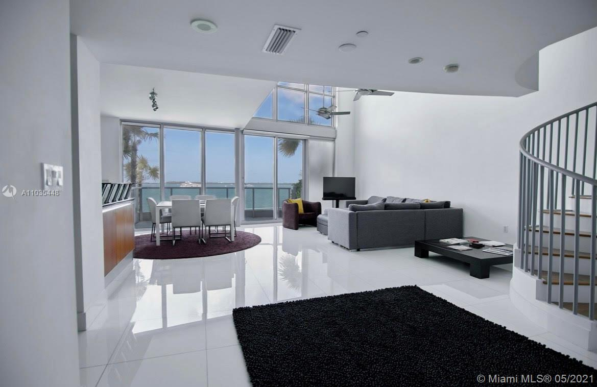 Gorgeous bay loft in the heart of Miami. Beautiful bay views. 2 bedrooms 2 baths with direct access to waterfront broad walk! You can´t miss this opportunity!! Amenities include: business center, rooftop pool, jacuzzi, gym, squash court and playground. Walking distance to shopping malls and restaurants!  This is a 1 bedroom + den the owner closed the den.
