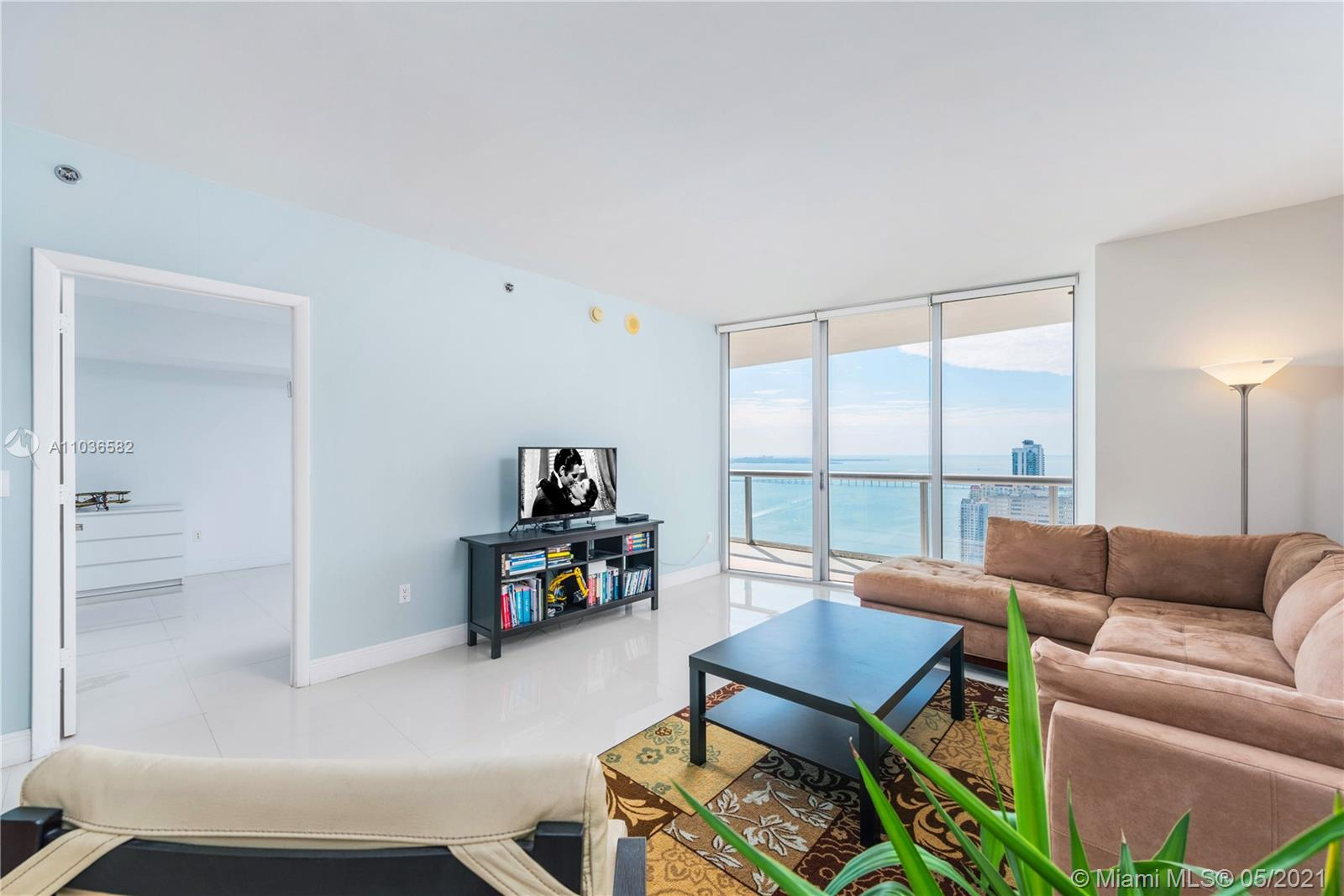 A spacious & bright 1 Bed, 1 Bath condo w/ over 1,000 interior square feet; white porcelain tiled floors in living areas; marble floors in the bathroom; a large, walk-in closet; kitchen appliances by Sub-Zero & Wolf; 10-foot-high ceilings w/ floor-to-ceiling glass windows, and breathtaking views of Biscayne Bay & city skyline from the 47th floor. The largest 1 bedroom floor plan at Icon Brickell. Includes 1 assigned parking space. Monthly condo dues cover basic cable TV, high-speed internet, and water. Building amenities include a 300-foot-long swimming pool, 50-person hot tub, poolside food & beverage service, movie theater, a 28,000-square-foot spa & fitness center, full-service concierge, on-site restaurants, and more. Within blocks of the shops & restaurants at Brickell City Centre.