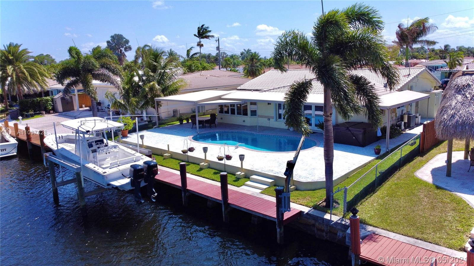 South Florida's Prime Ocean access 15 min,Deep Water Canal dream home, won't last long. With an 2,004 sqft2 this Beautiful, remodeled and addition (2007) of Master Bedroom, Sitting Room, Extra On-Suite Bedroom, Converted garage total 3/2 home in desirable Garden Isles. 2020 - Pool pump ;2018 - Diamond bright resurface pool ;2008 - All plumbing & electrical re-done; 2016 - Flat roof & 2000 - Main Roof ;Partial Impact and hurricane shutters; 2020 - Seawall/pilings ; 2000 - Boatlift 13,000 pounds; Complete Roof Insulation; Open kitchen and patio with salt water pool and outdoor spa make this home the perfect getaway to dock your yacht and enjoy boating at its best. 70' sea wall and dock. 2 outside storage space, Complete Roof Insulation ,tankless water heater and more.