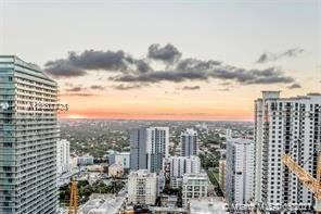 Spectacular unit at the iconic 1010 Brickell Condo. Unit features: 2 beds, 2 baths, amazing views, tile floor, glass-enclosed shower, custom made closets, window treatments, 9-foot ceiling heights, top of the line appliances, 1 parking space! Live & play in this luxury building with an outdoor movie theatre, restaurant & swimming pool at 50th floor roof top; Co-ed Hammam spa w cold & hot Jacuzzi, massage & treatments rooms, sauna & steam room at 12th floor; basketball & racquetball courts, running track, indoor heated swimming pool, fitness center, party room w kitchen, open terrace & barbecue, kids room w bowling, virtual golf simulator, ping-pong, among others. Excellent location next to public transportation, Brickell City Centre, & more.