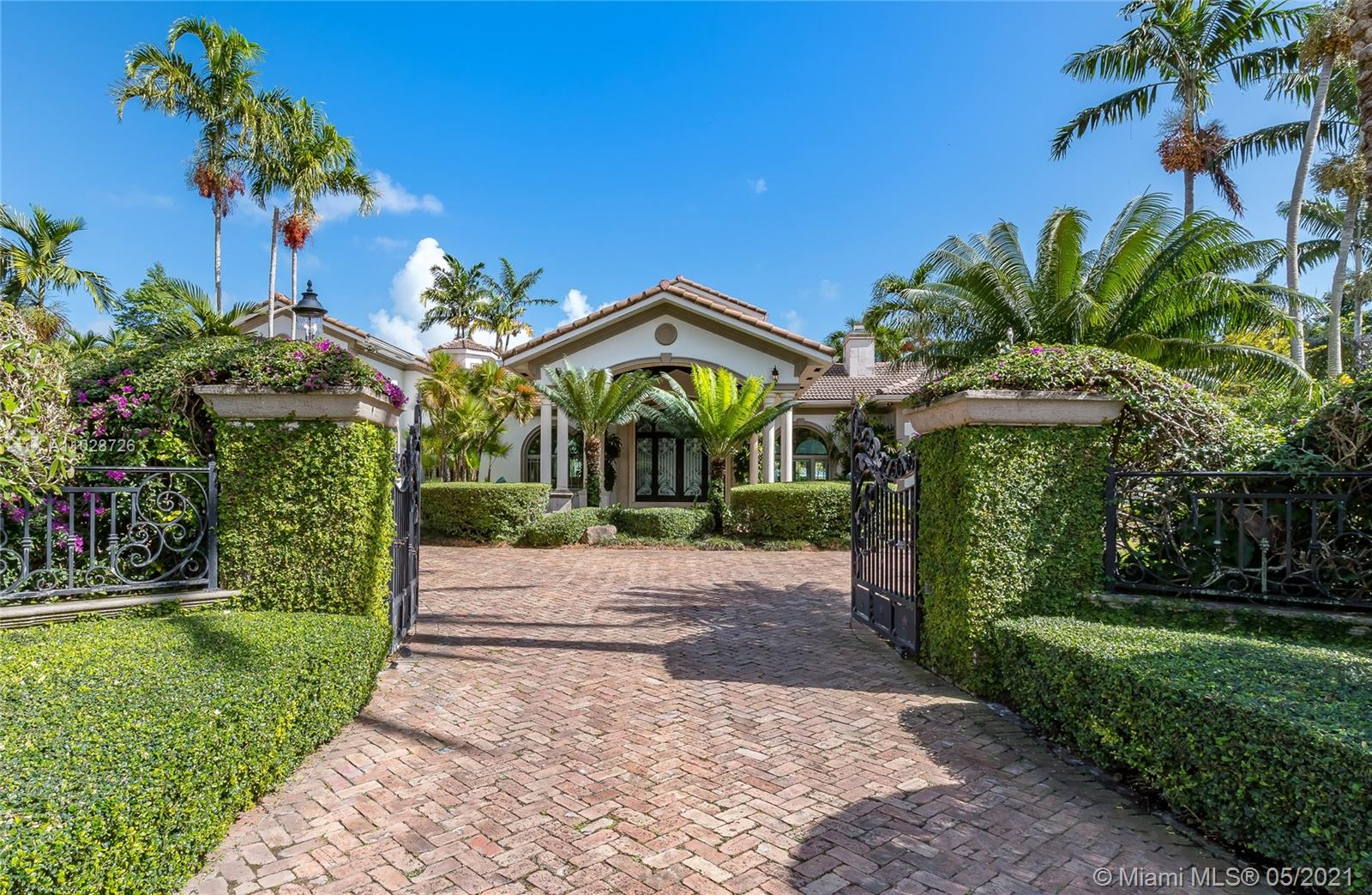 This spacious one story home located in N Pinecrest is privately gated & sits on 36,590 sqft of land. Front doors open to a beautiful view of the salt water/heated pool and backyard with large entertaining spaces and state of the art summer kitchen, surrounded by pristine & lush landscaping.  Enjoy marble floors and wood paneling throughout formal and informal living room plus dining and wood floors throughout the 6 beds/6.5-baths house, as well as high vaulted ceilings, high impact windows, recessed lighting, a fireplace, and a maid's quarter. The Master suite offers a sitting area as well as oversized closets and large bathroom/sauna with his and her sinks. Bright, open kitchen features top appliances such as Miele and Sub Zero. 3 car garage. Near top ranked schools, marinas and more!