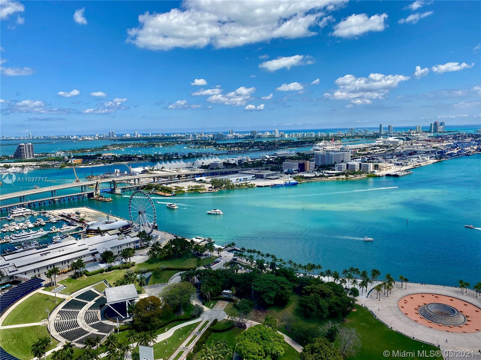 """LOCATION! Heart of city with a multimillion dollar VIEW!! EVERY ROOM and your FINISHED balcony unobstructed VIEWS bay, cruise ships, port & Bayside Fireworks! Pride of ownership in 2-2+DEN is evident! Meticulous detail built ins, his/her closets, flooring, doors, hinges, handles and trim! The contemporary soft colors reflect downtown lifestyle, all within steps of the secure entry. Walk to The Perez Art Museum, AAA arena, Bayside Park and Marketplace, Dine & shop WholeFoods are only part of location! 50 Biscayne has it all, the 3 story lobby with lush greenery and soothing water feature, the 10th floor Oasis features infinity edge pool, cabana, state of art gym. The revitalization of """"FLAGER STREET"""" will be the BEST of Miami's New Downtown! FURNITURE Negotiable! Den unit is included!"""