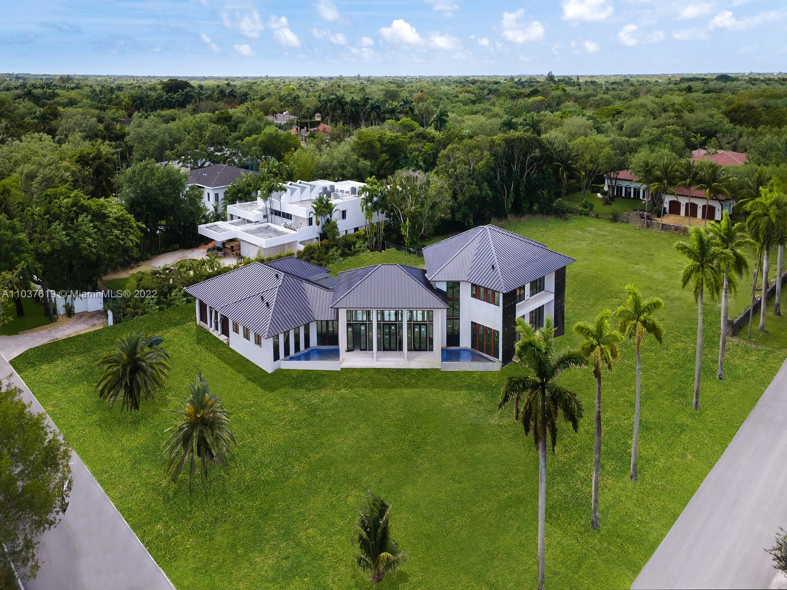This gracious new-built residence, sprawling across a generous property in the heart of Miami's prestigious Village of Pinecrest, is slated for completion in the fall of 2021, with all the features of an aristocratic subtropical villa and the luxuries of a modern estate. At the center of the almost 8,000 square-foot home is the vaulted Great Room, surrounded by family areas, a pool with baja shelf and integrated jacuzzi, and multiple covered terraces, embracing the very Floridian desire for an indoor-outdoor lifestyle. The eight bedrooms, all with an ensuite bath and walk-in closet, include a maid's room and lavish master suite that includes an oasis-like bath and dressing room. Outside, the 34,863 square foot estate gives you plenty of room to play with.